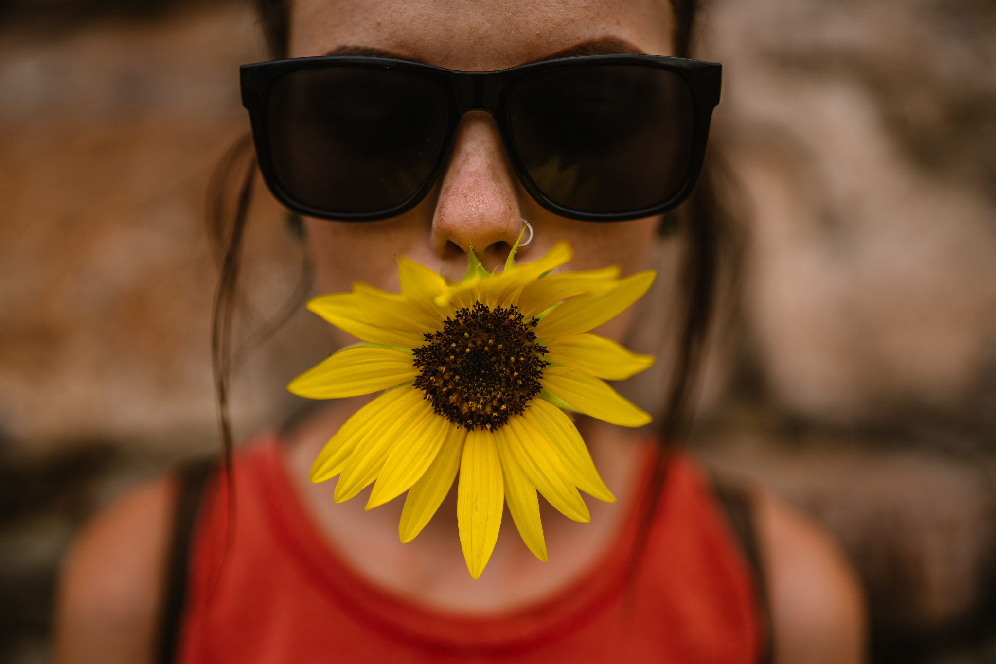 san diego wedding   photographer | woman in shades with sunflower in her mouth