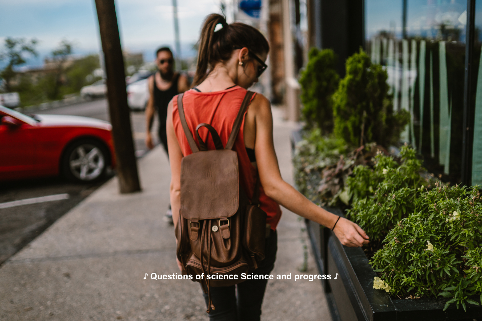 san diego wedding   photographer | woman with brown leather backpack picking at plants