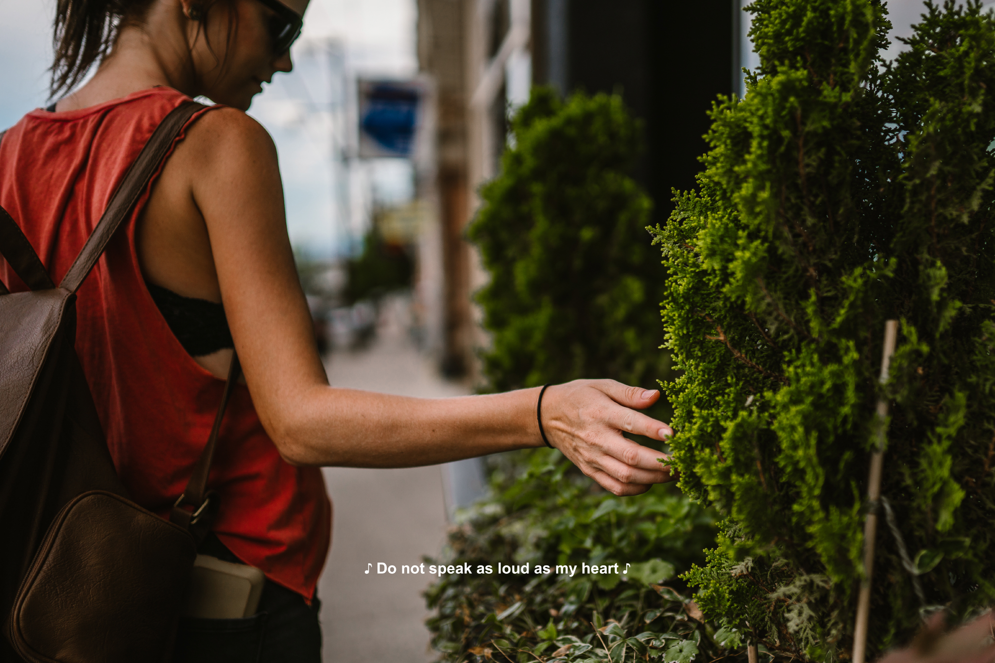 san diego wedding   photographer | woman with brown leather backpack captioned