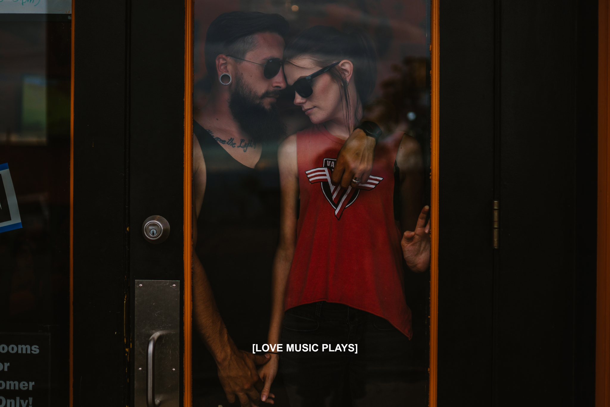 san diego wedding   photographer | couple with shades on seen through store glass window