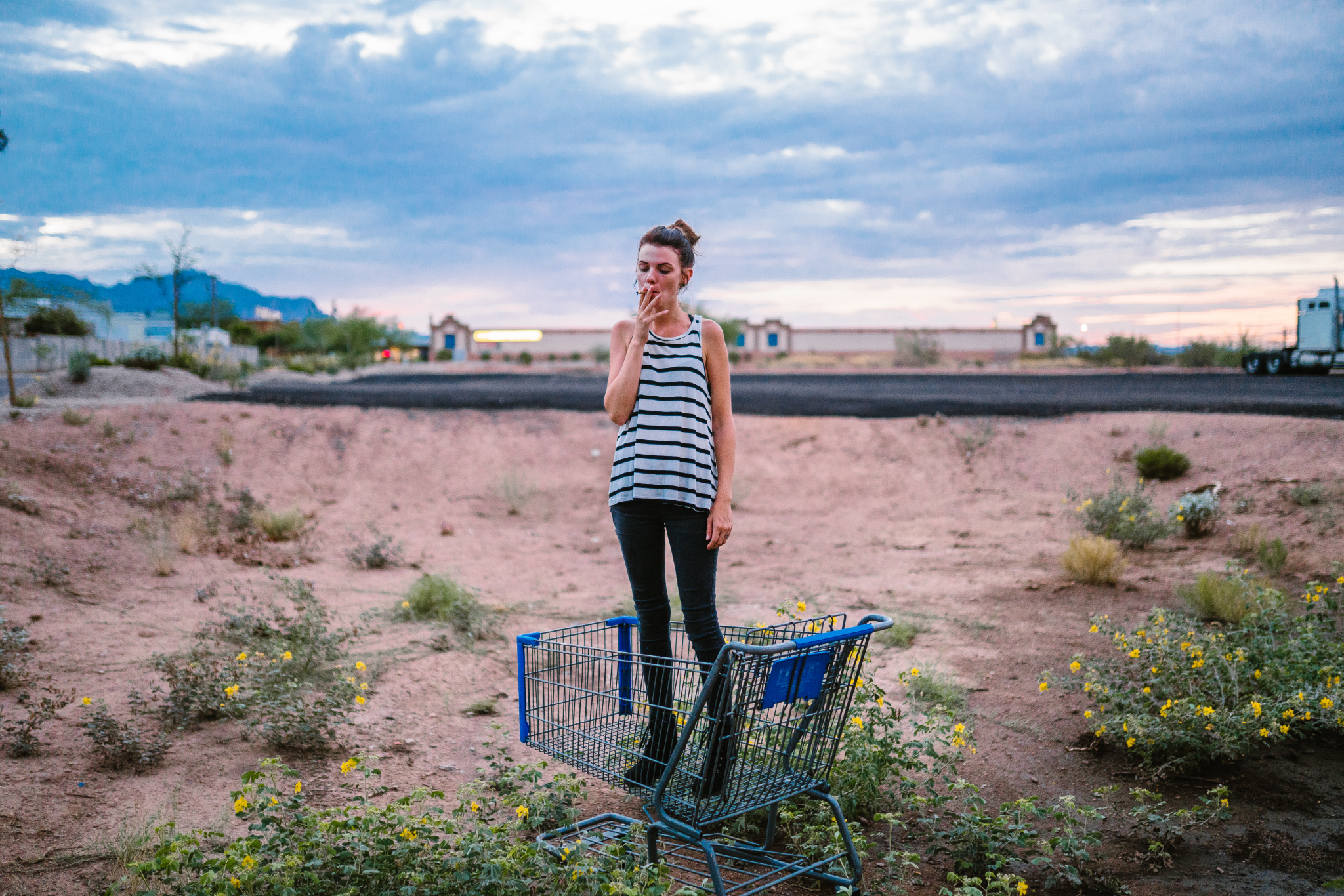 san diego wedding   photographer | woman standing in blue shopping cart smoking