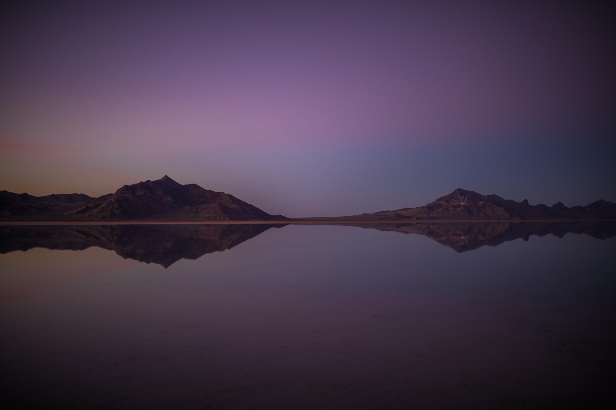 san diego wedding   photographer | bonneville salt flats and purple-blue sky with two mountain   ranges