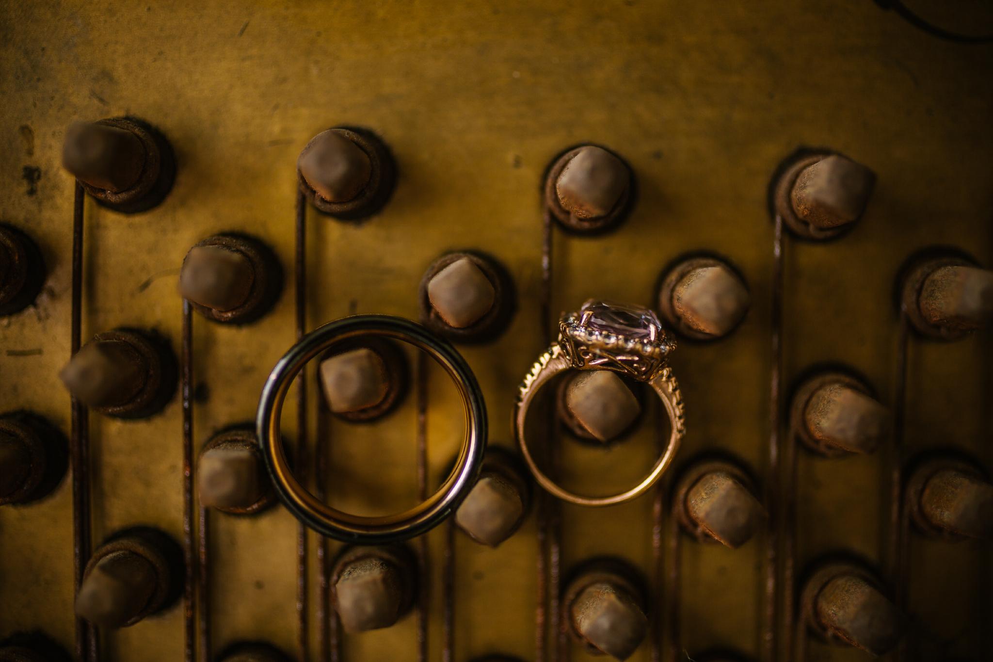 san diego wedding   photographer   rings on a wall