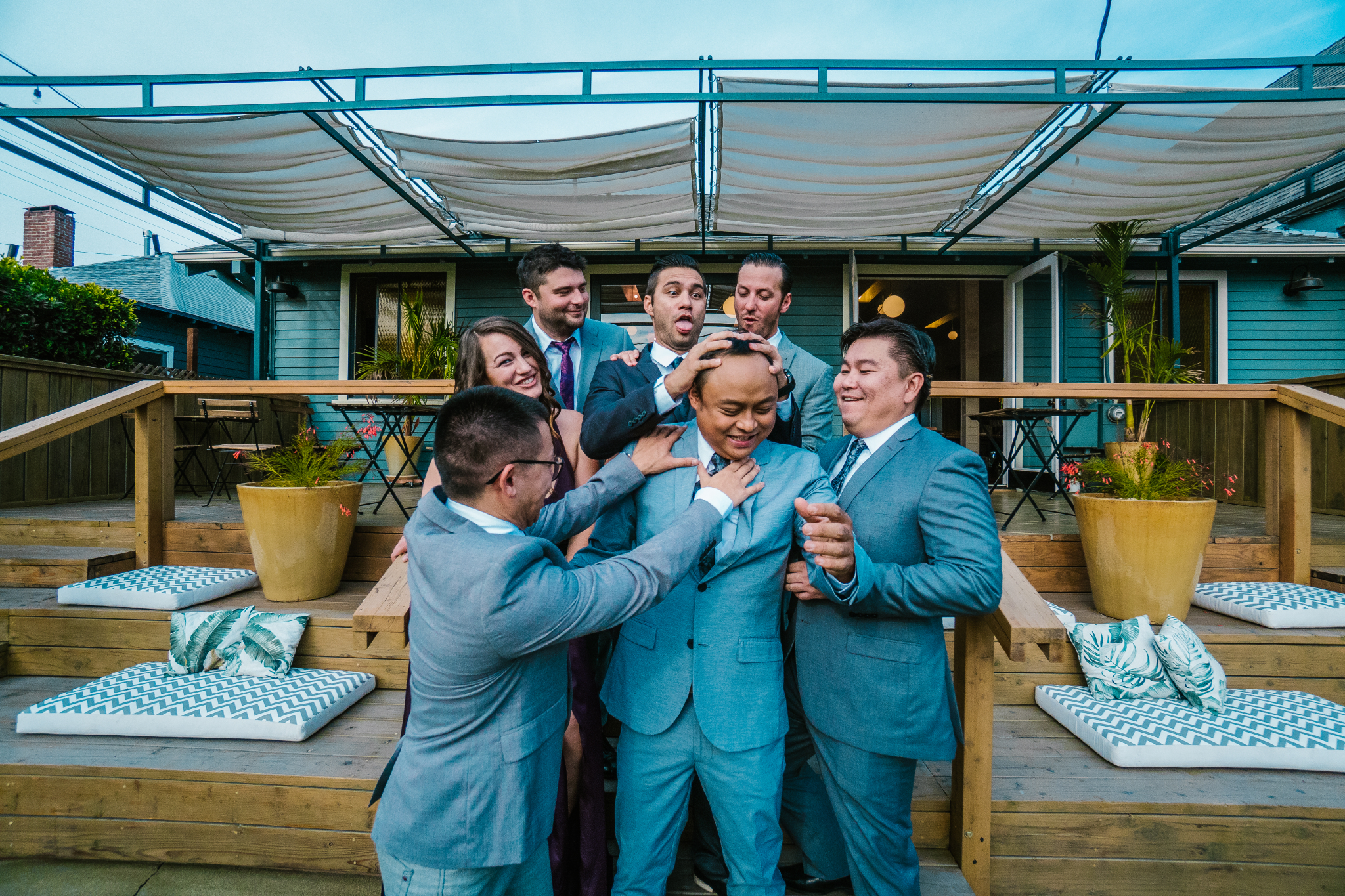 san diego wedding   photographer | group of people touching man on staircase