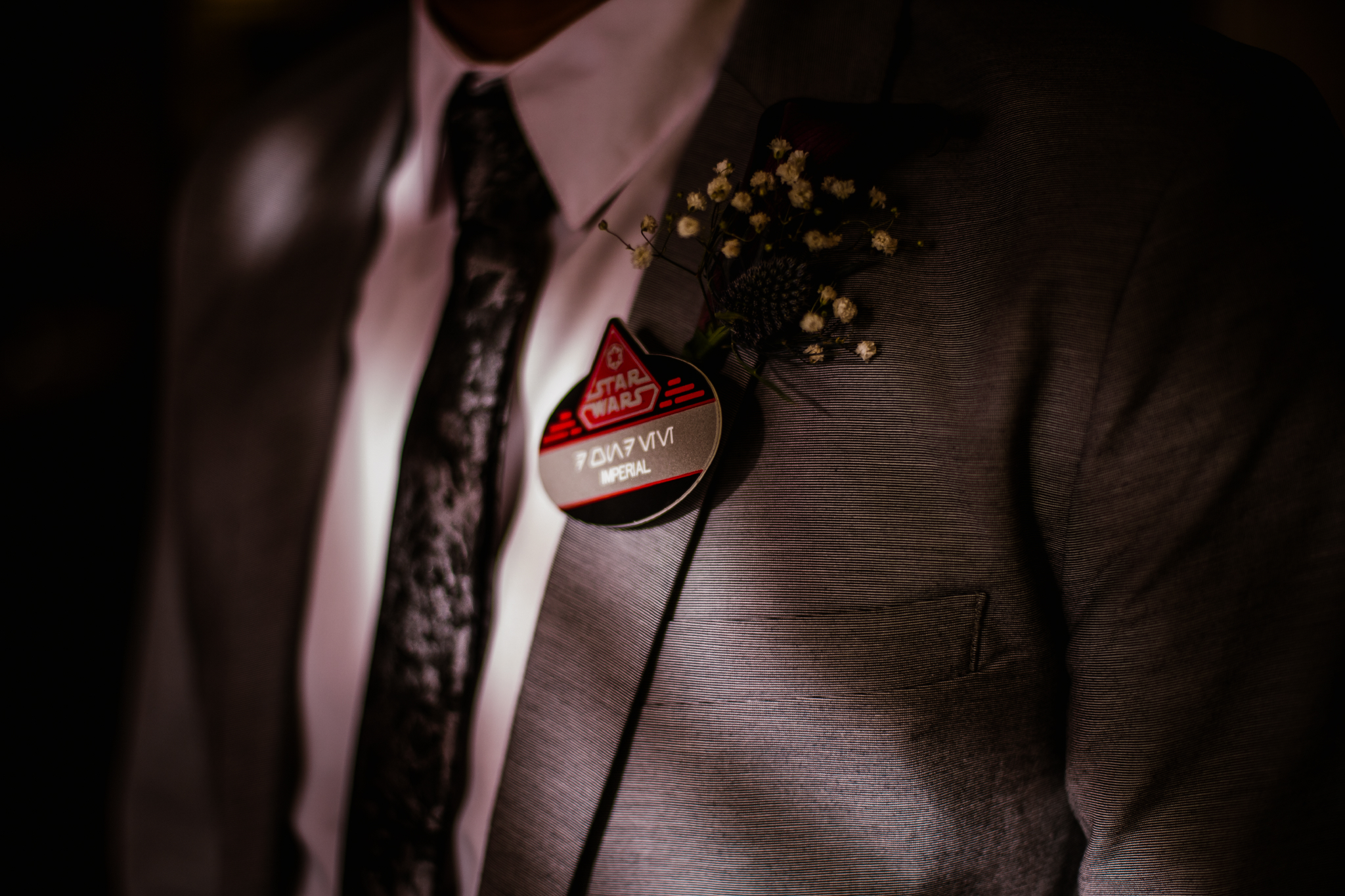 san diego wedding   photographer   suit with star wars pin on it