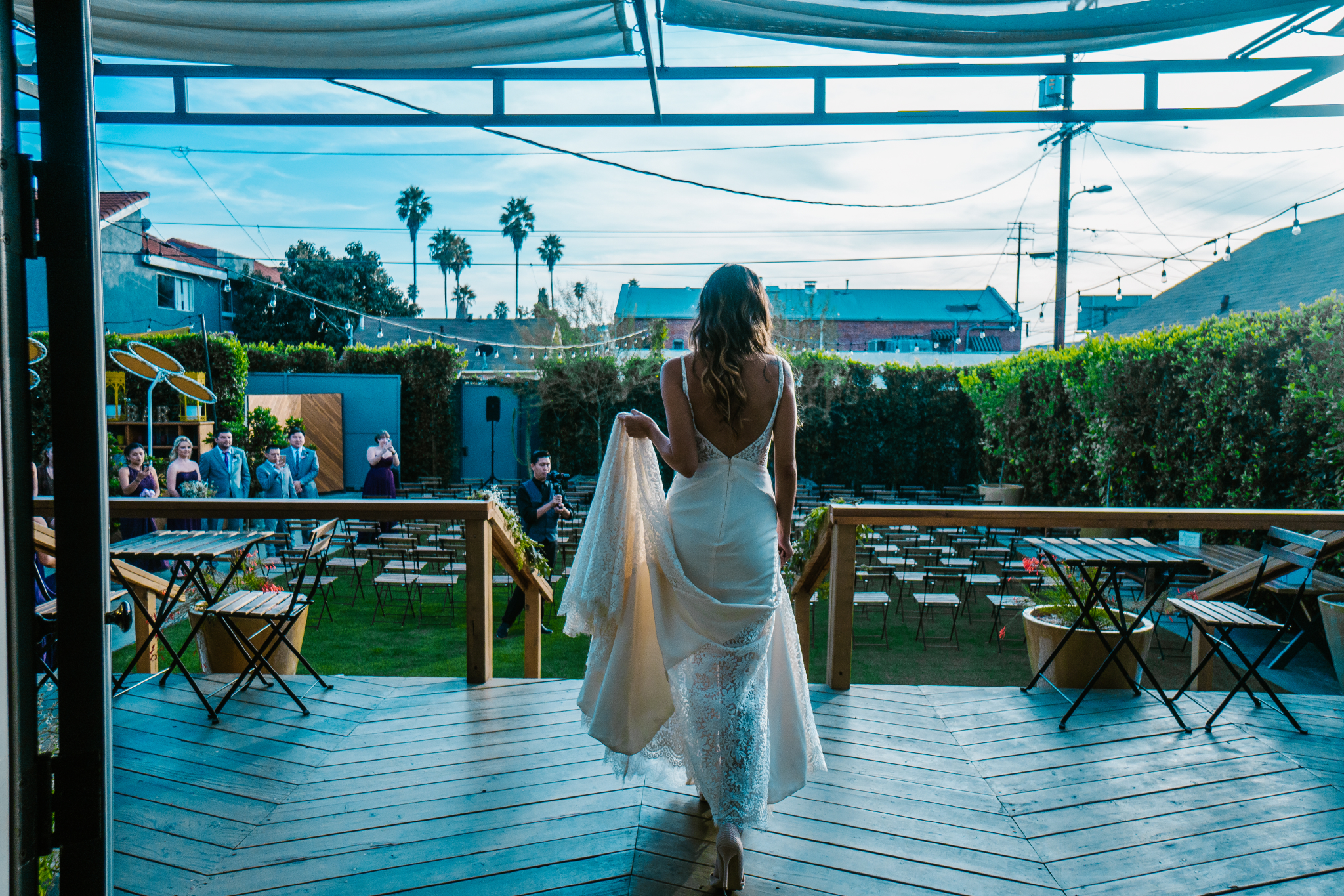 san diego wedding   photographer | bride outside carrying skirt