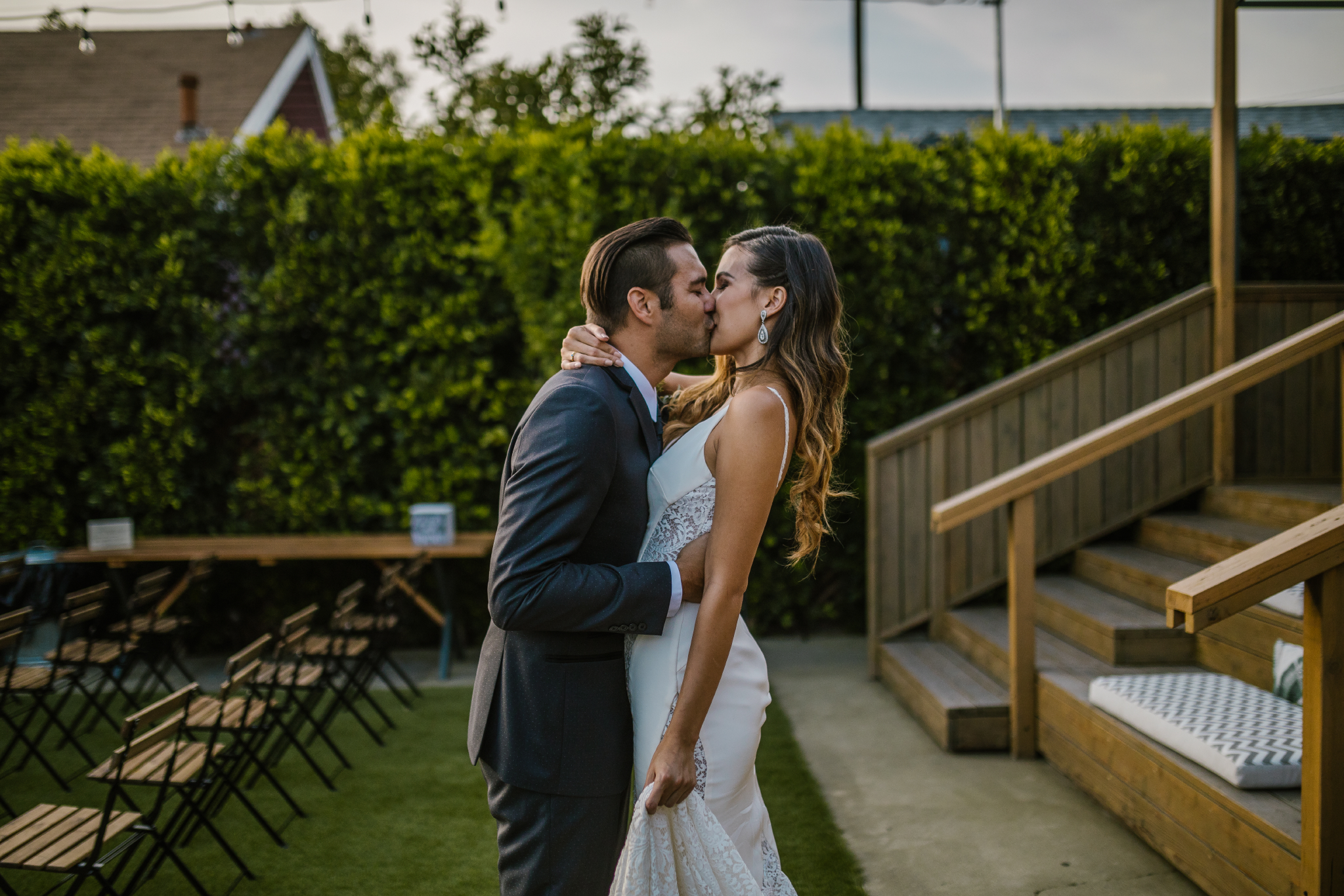 san diego wedding   photographer | bride kissing groom at foot of staircase