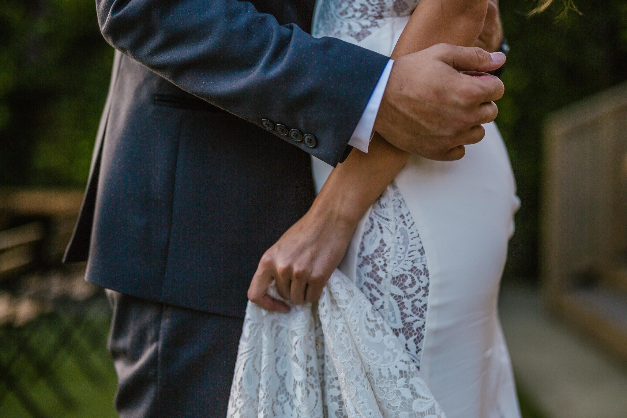 san diego wedding   photographer   lower body of groom holding bride close
