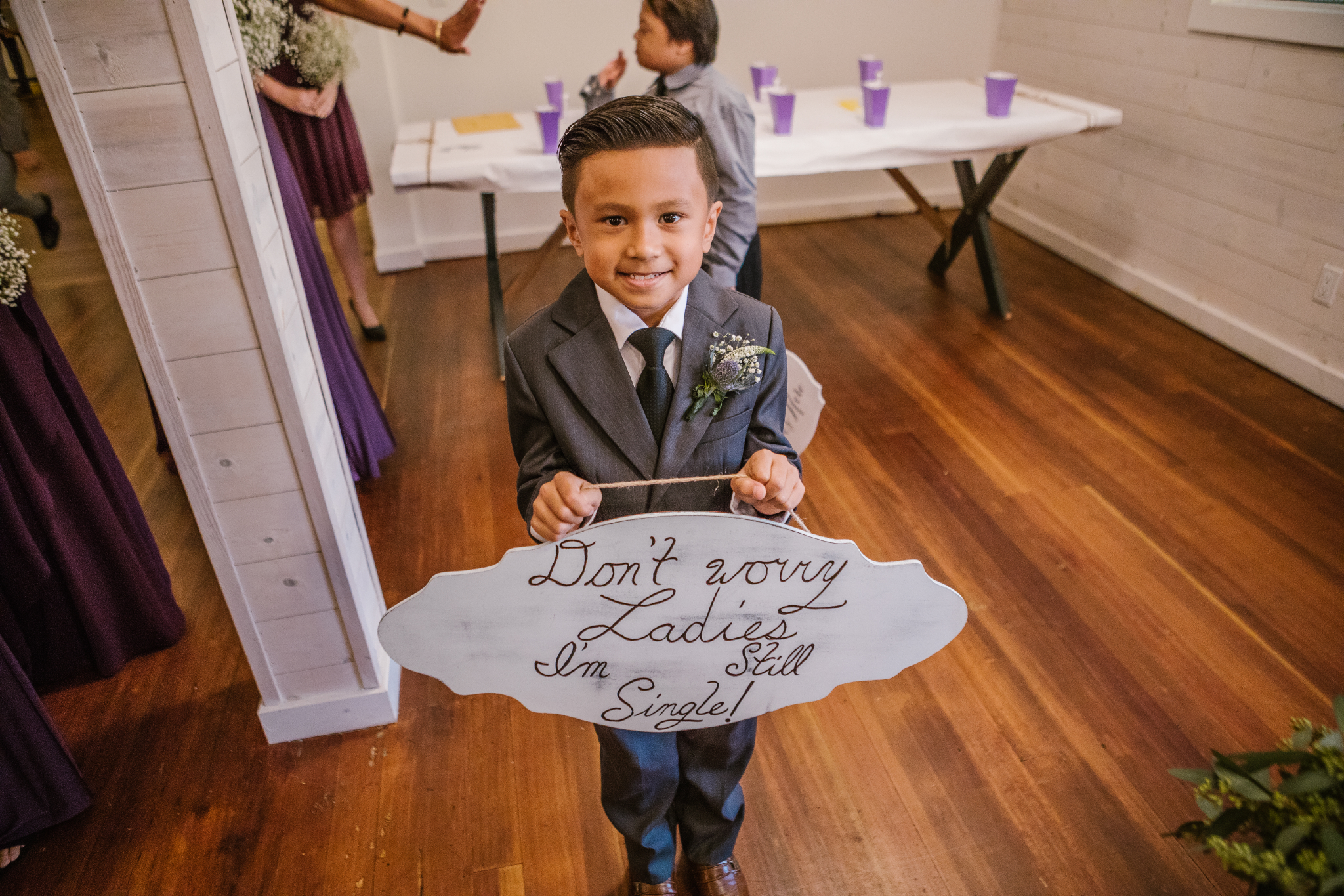 san diego wedding   photographer | child in suit carrying sign