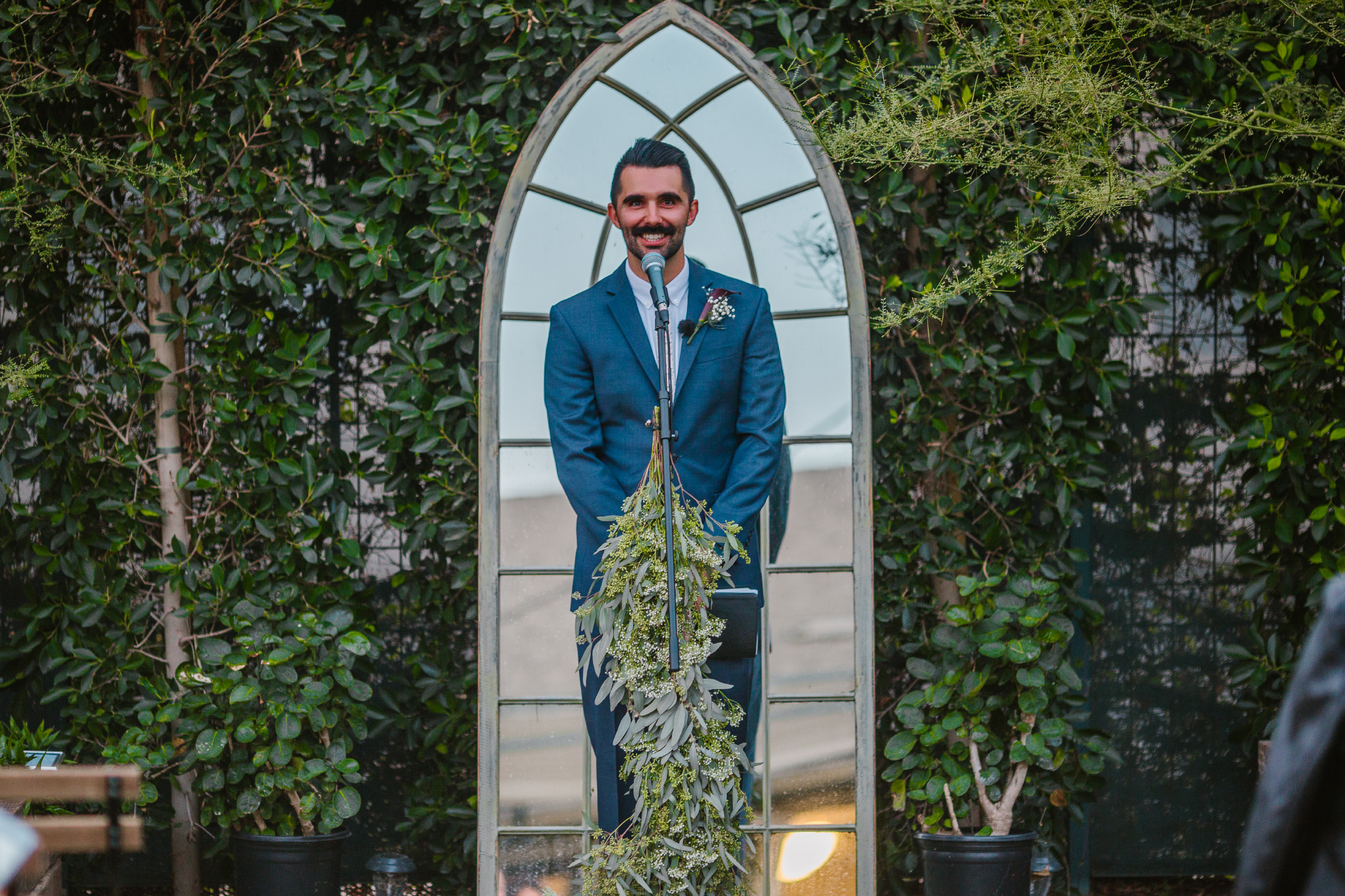 san diego wedding   photographer | man in grey suit speaking to mic