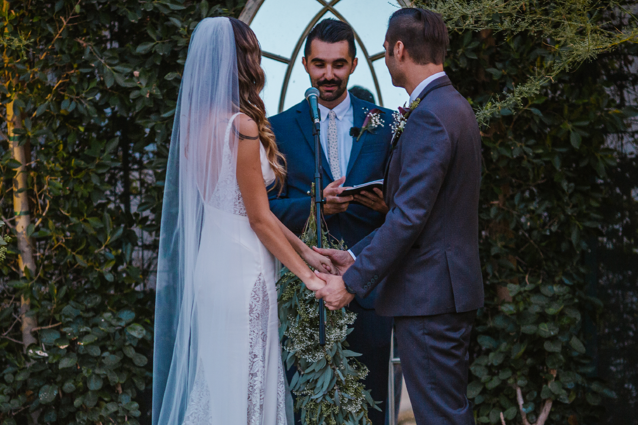 san diego wedding   photographer   officiator reading something in front of couple to be married