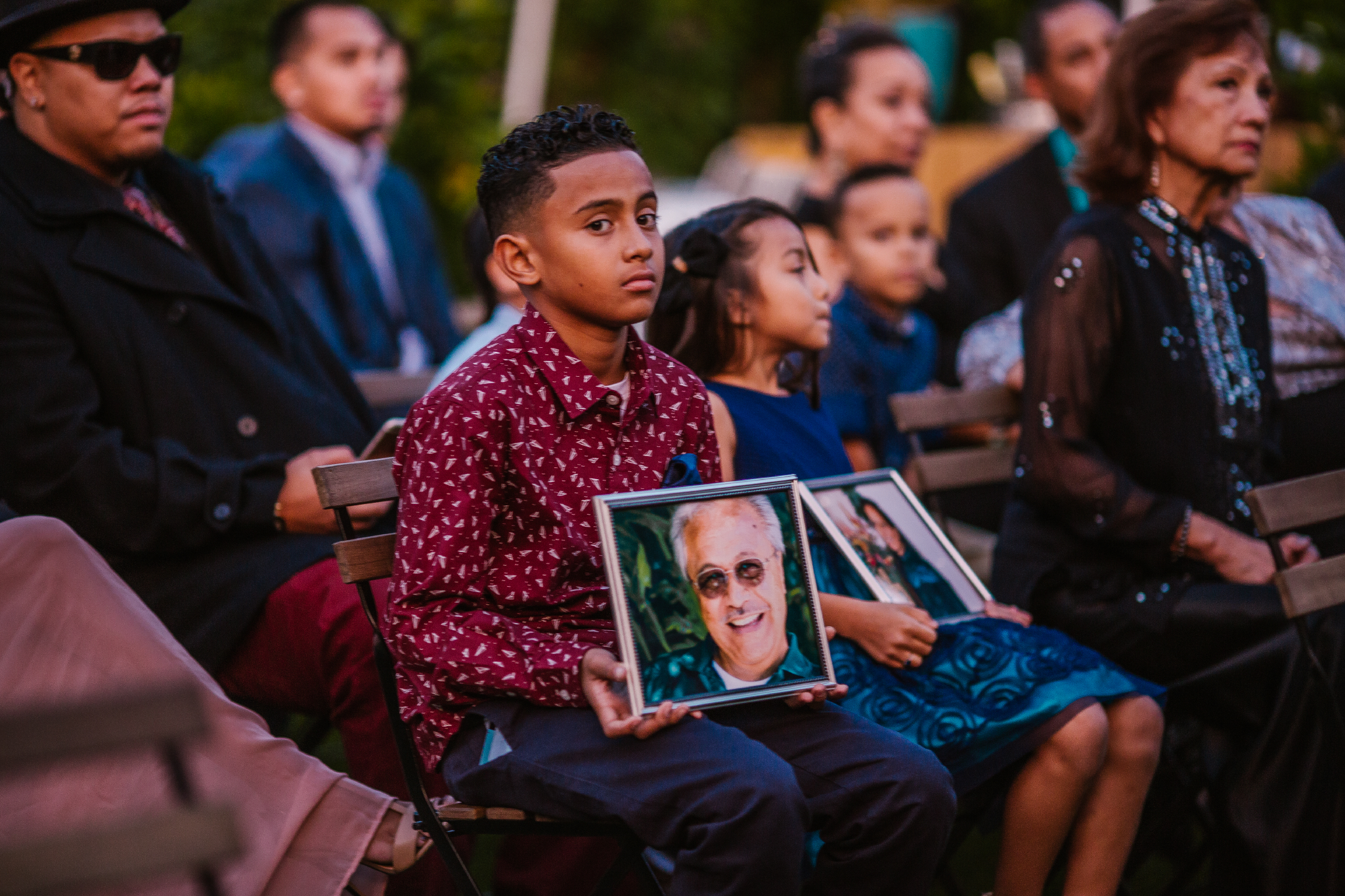 san diego wedding   photographer | child in crowd carrying picture frame looking into camera
