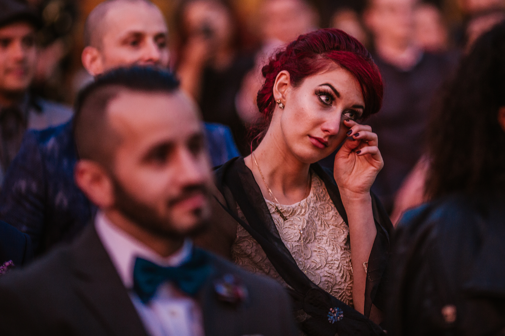 san diego wedding   photographer   woman with red hair in crowd tearing up
