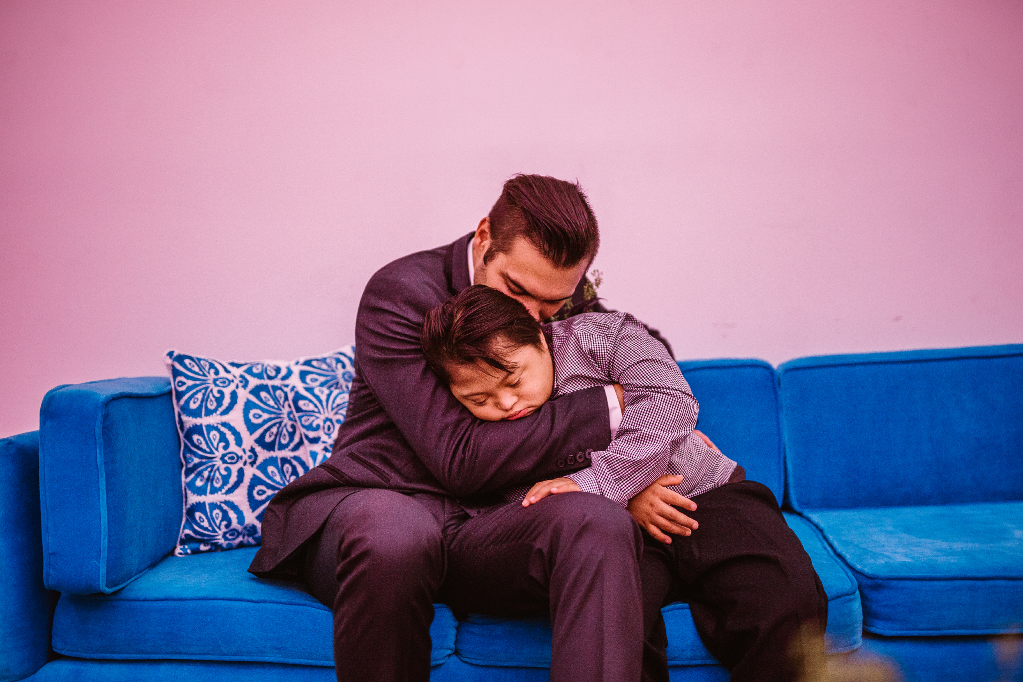 san diego wedding   photographer | groom hugging sleeping child on couch