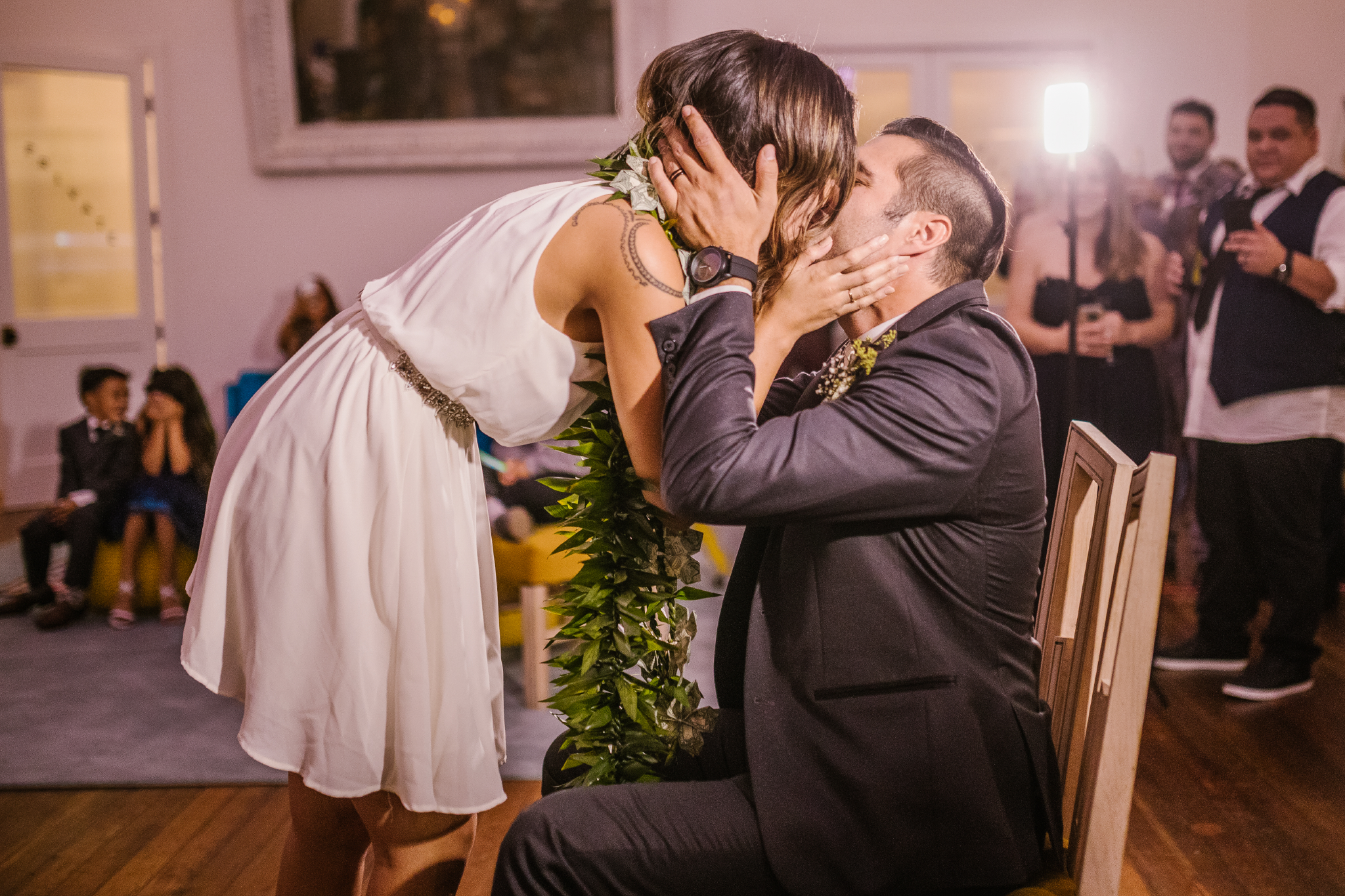 san diego wedding   photographer | bride and groom kissing with lighting in background