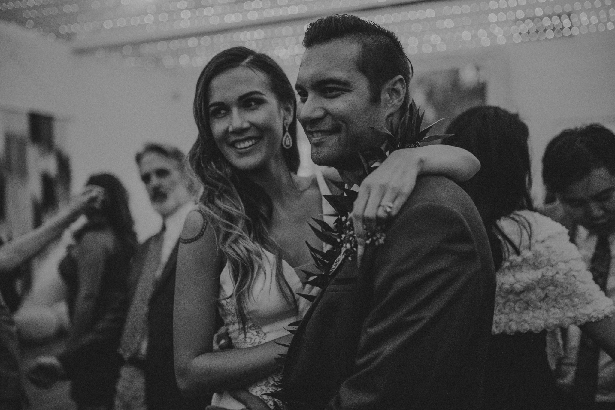 san diego wedding   photographer   monotone picture of bride posing with man