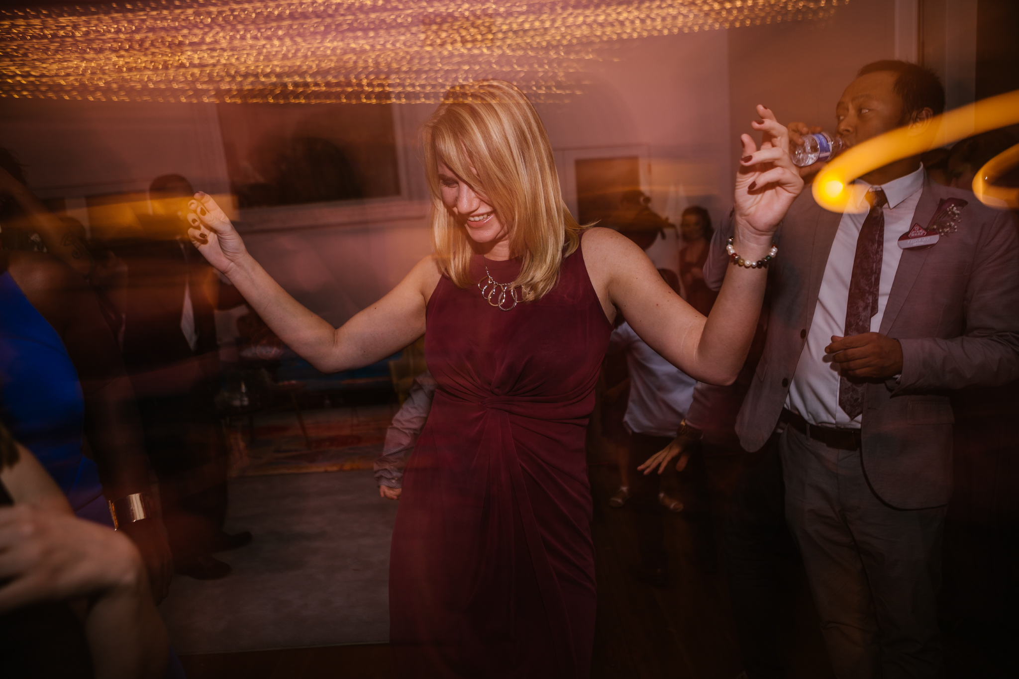 san diego wedding   photographer | long exposure shot of woman in purple dancing