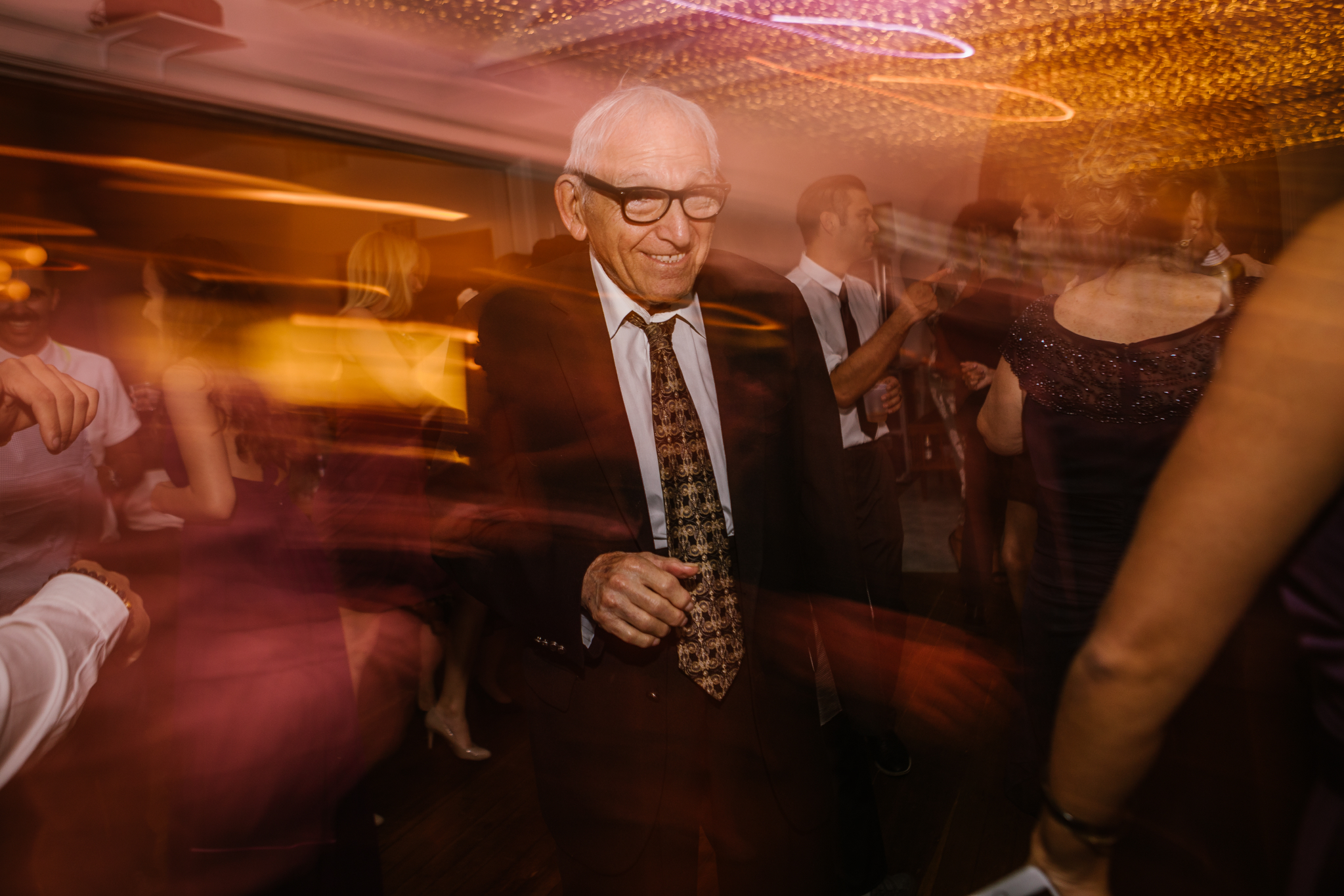 san diego wedding   photographer | long exposure shot of old man dancing on dance floor