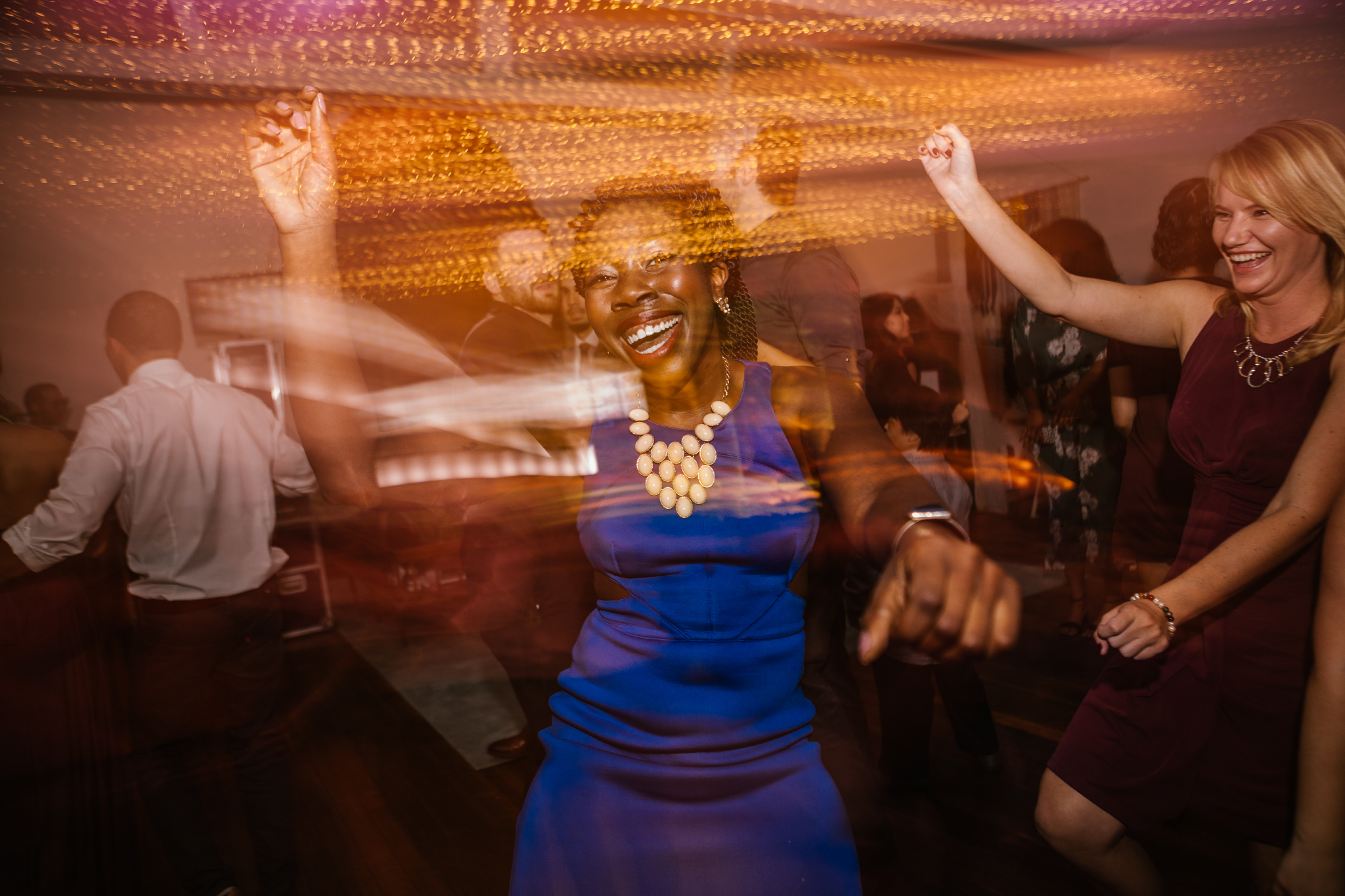 san diego wedding   photographer   long exposure shot of woman in blue dancing