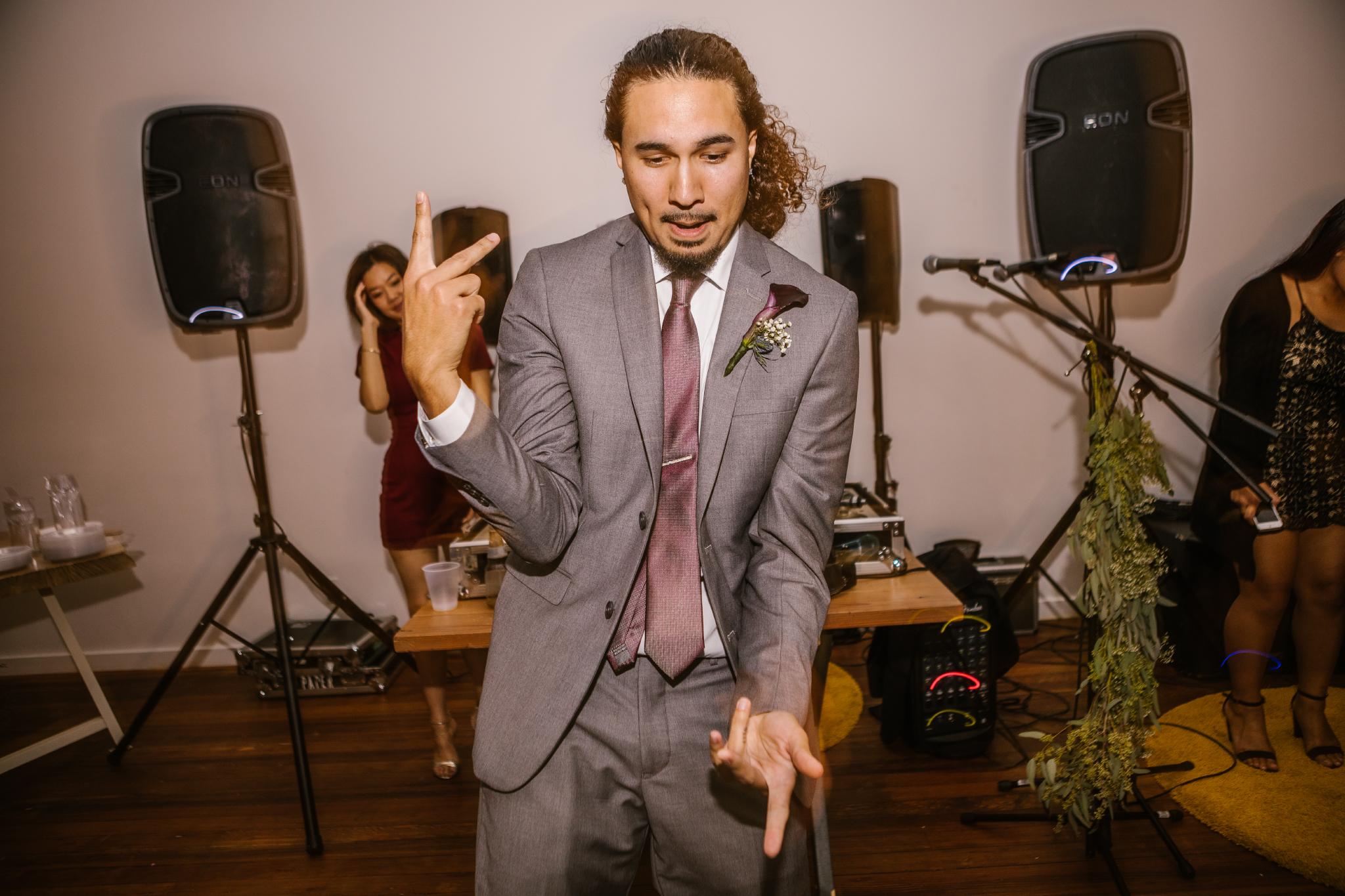 san diego wedding   photographer   man dancing in front of speakers