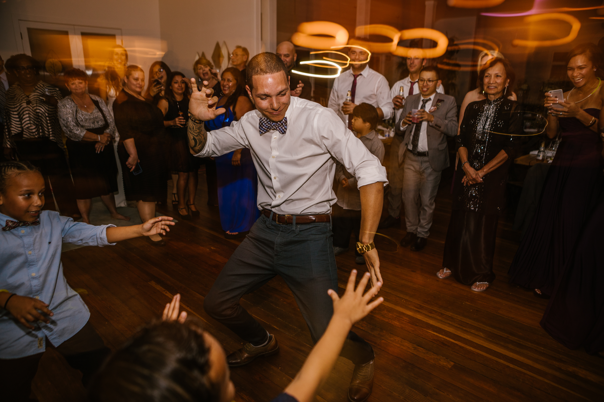 san diego wedding   photographer | man dancing with kids on dance floor