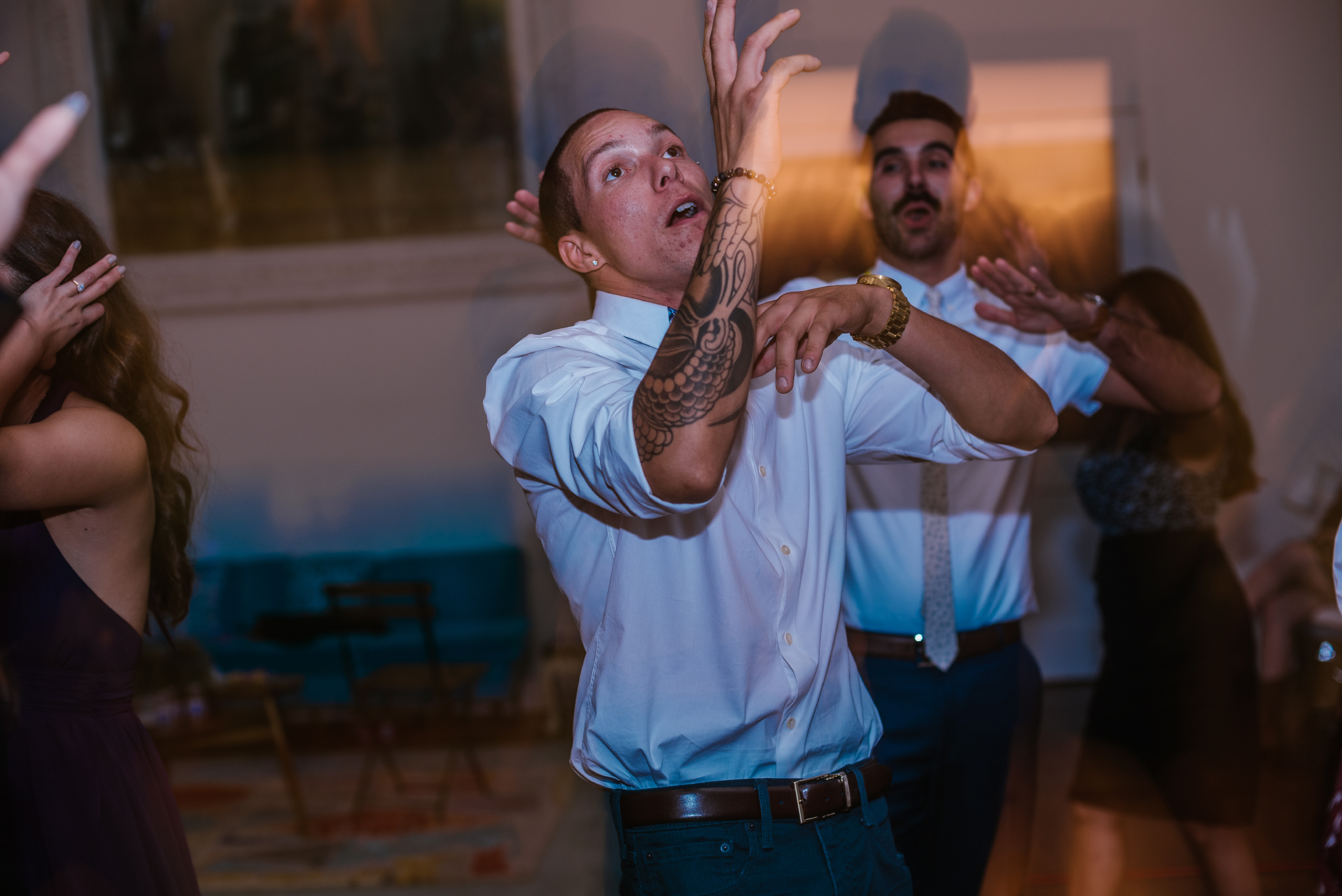 san diego wedding   photographer   slightly distorted picture of men dancing