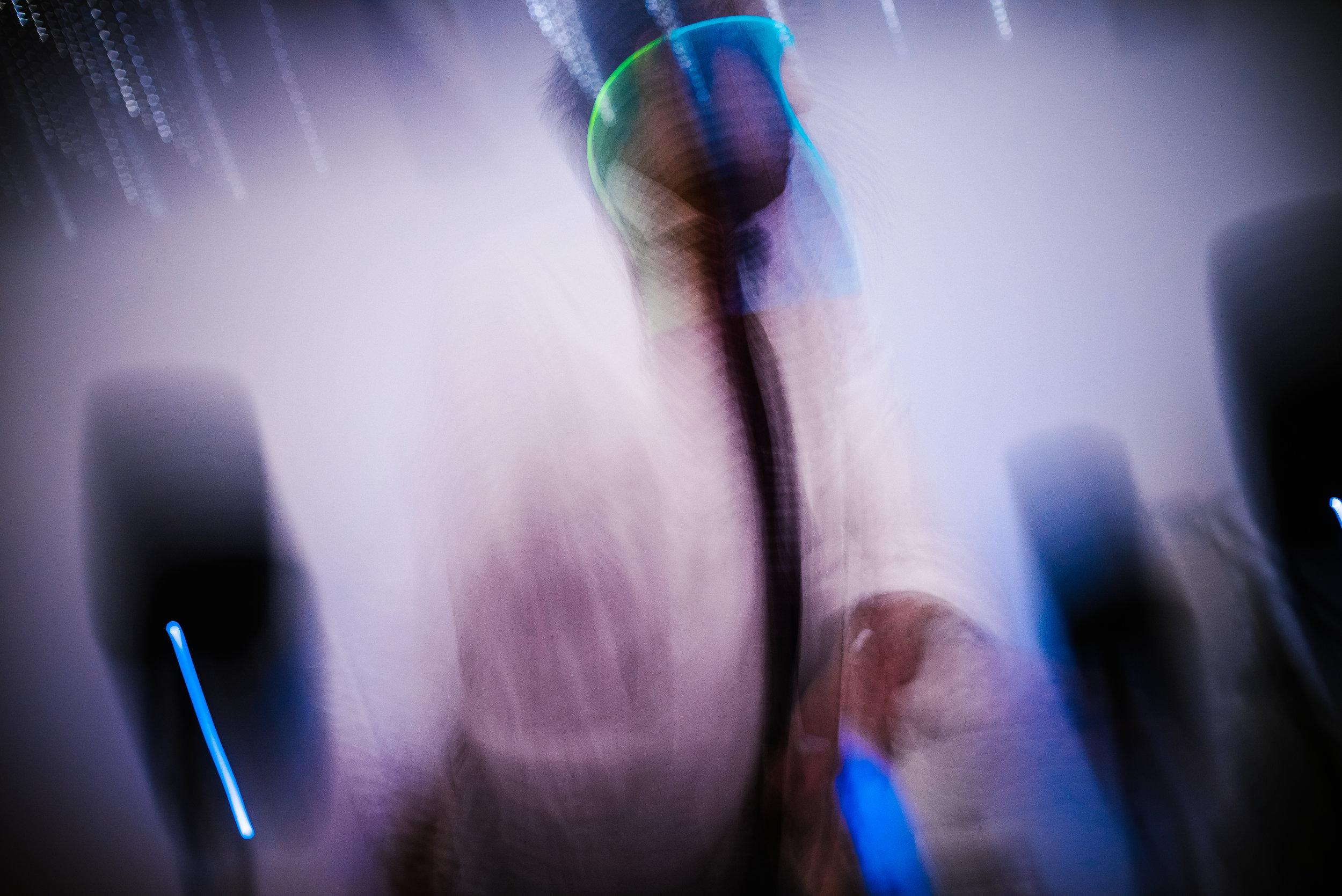 san diego wedding   photographer   man wearing glowsticks on head dancing