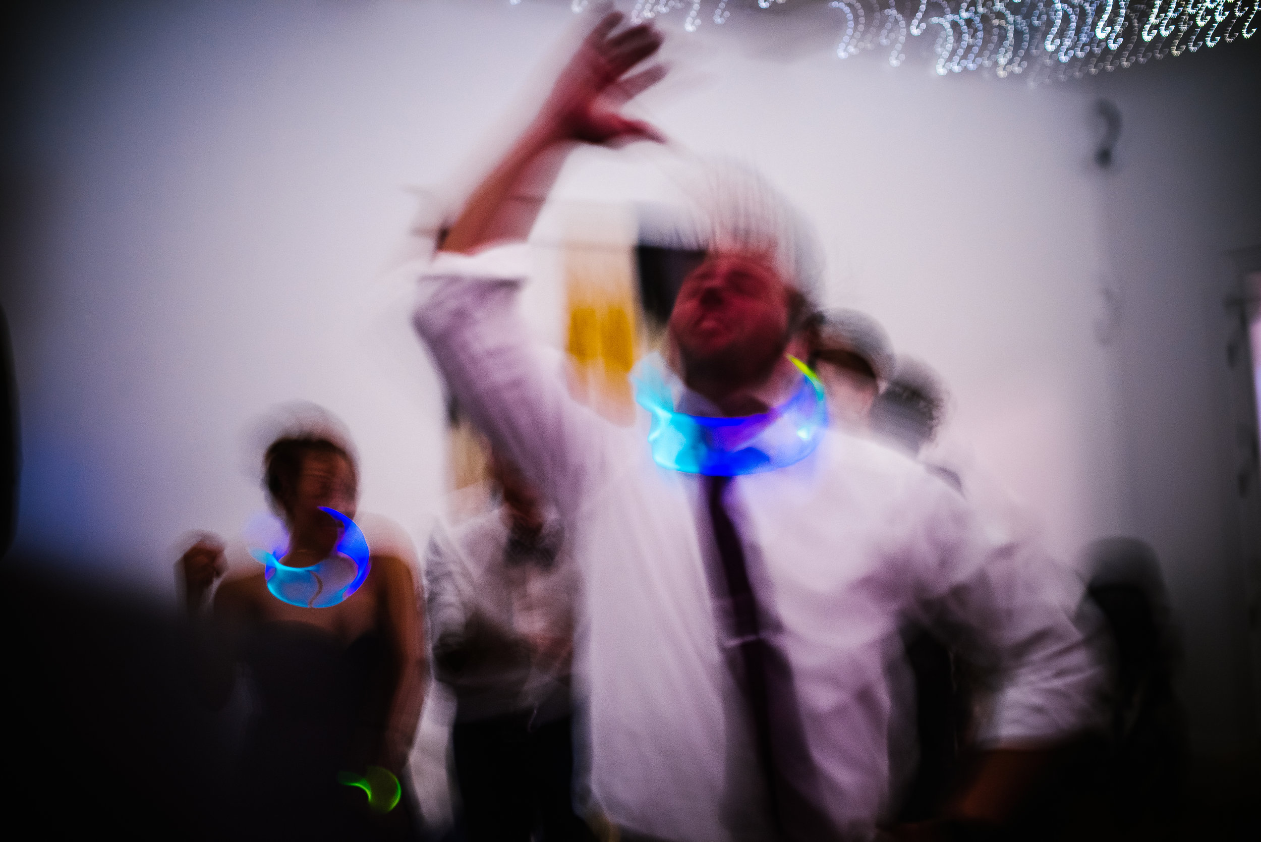 san diego wedding   photographer | man with glowsticks around neck dancing