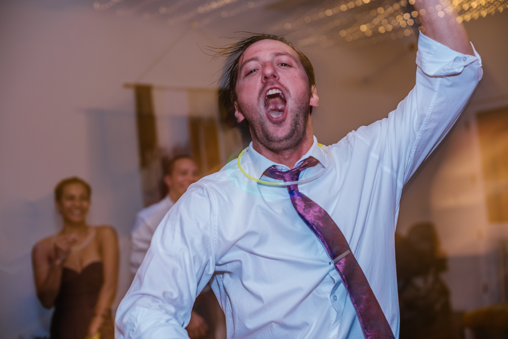 san diego wedding   photographer | blurred shot of man dancing with glowsticks