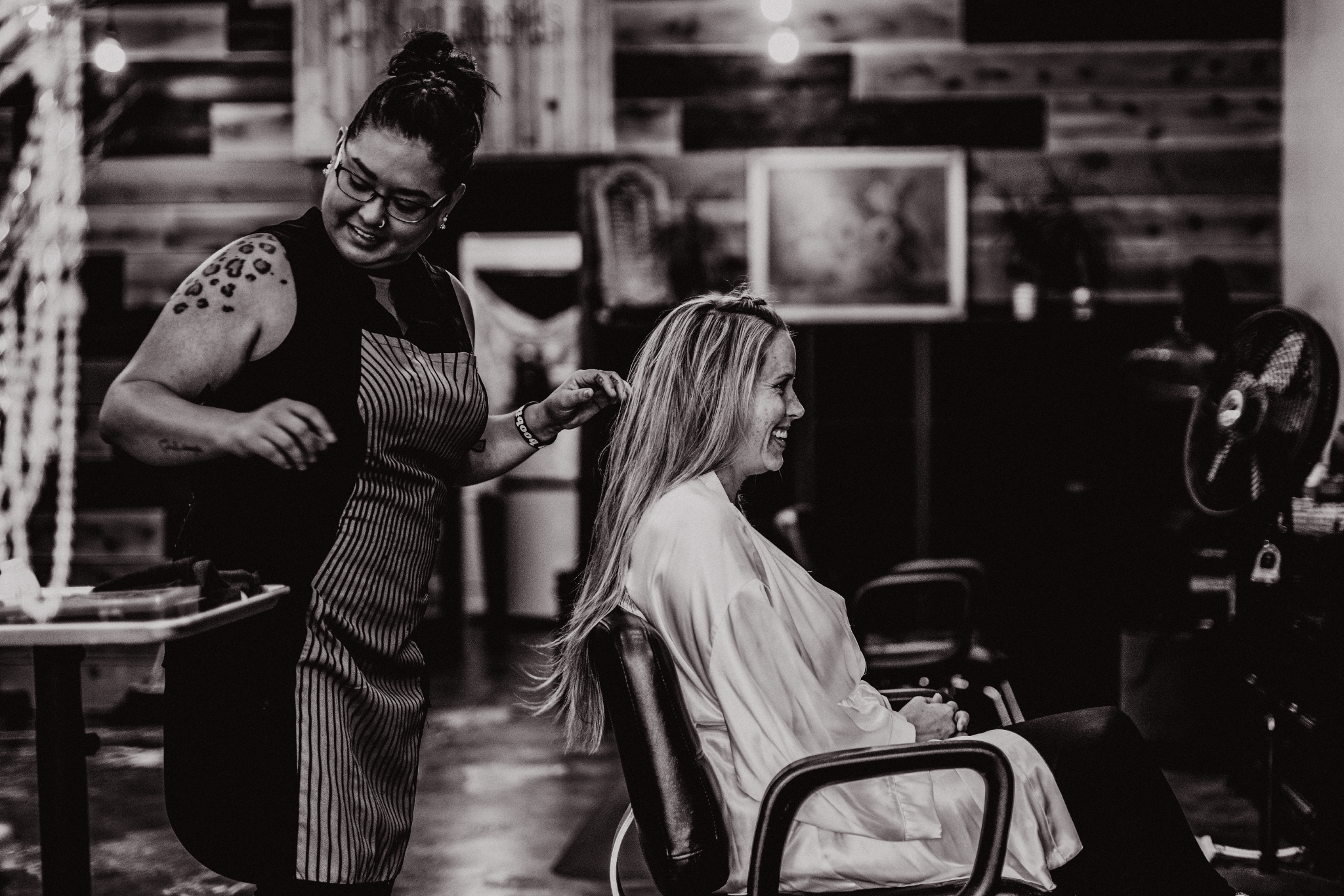 san diego wedding   photographer | woman sitting in chair getting hair done