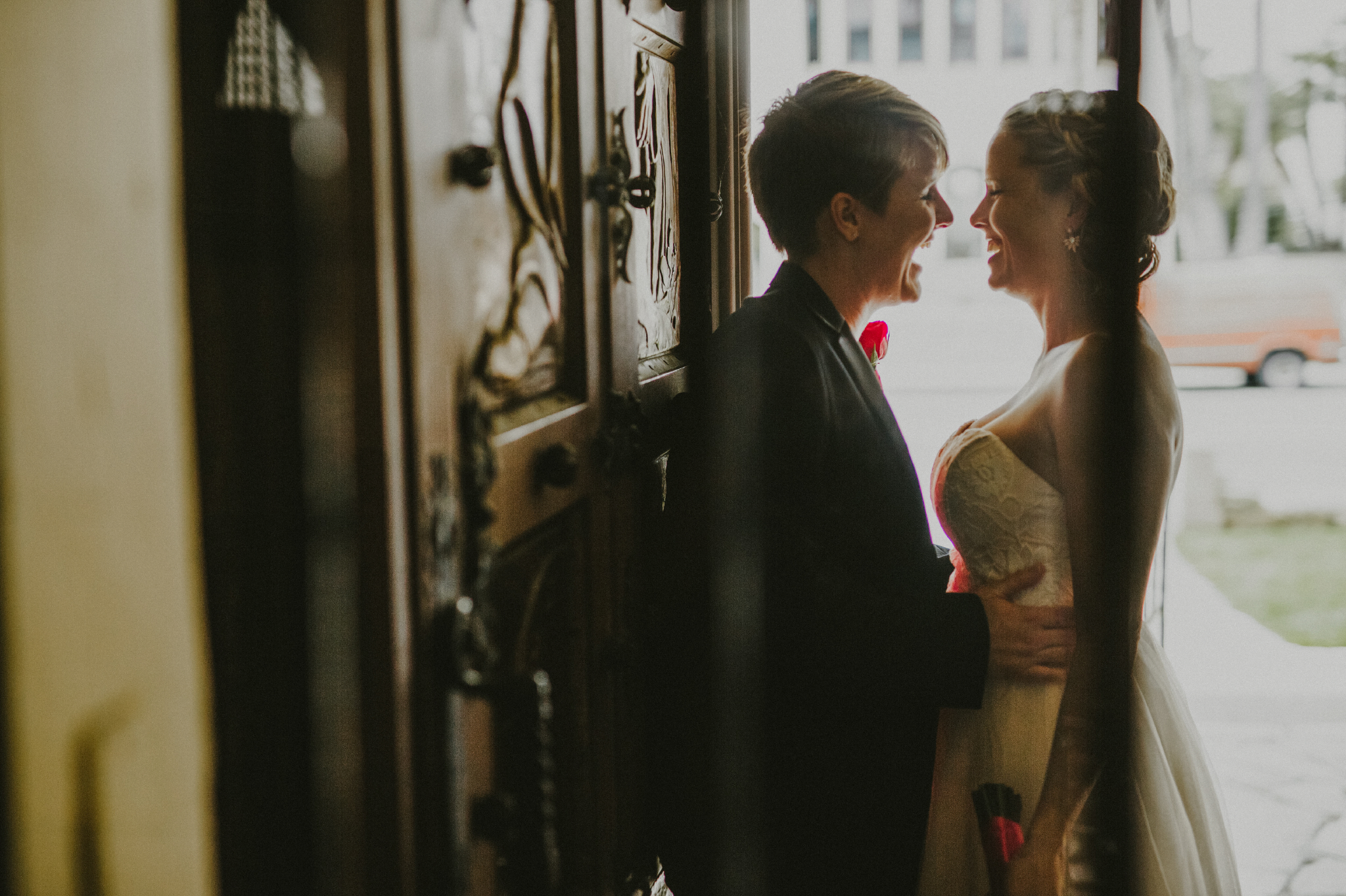 san diego wedding   photographer | 2 women laughing in front of each other in doorway
