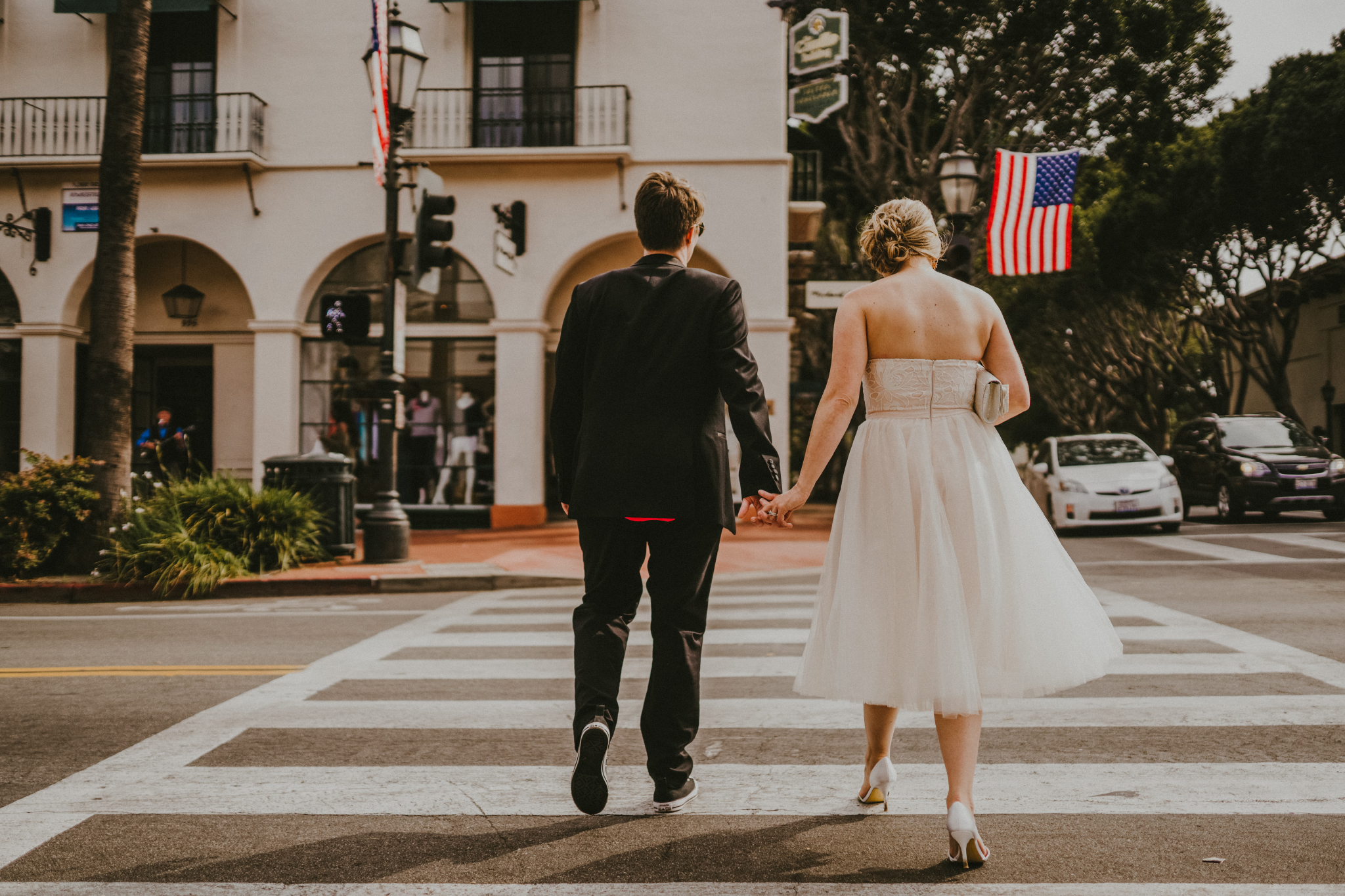 san diego wedding   photographer | women holding hands crossing the road