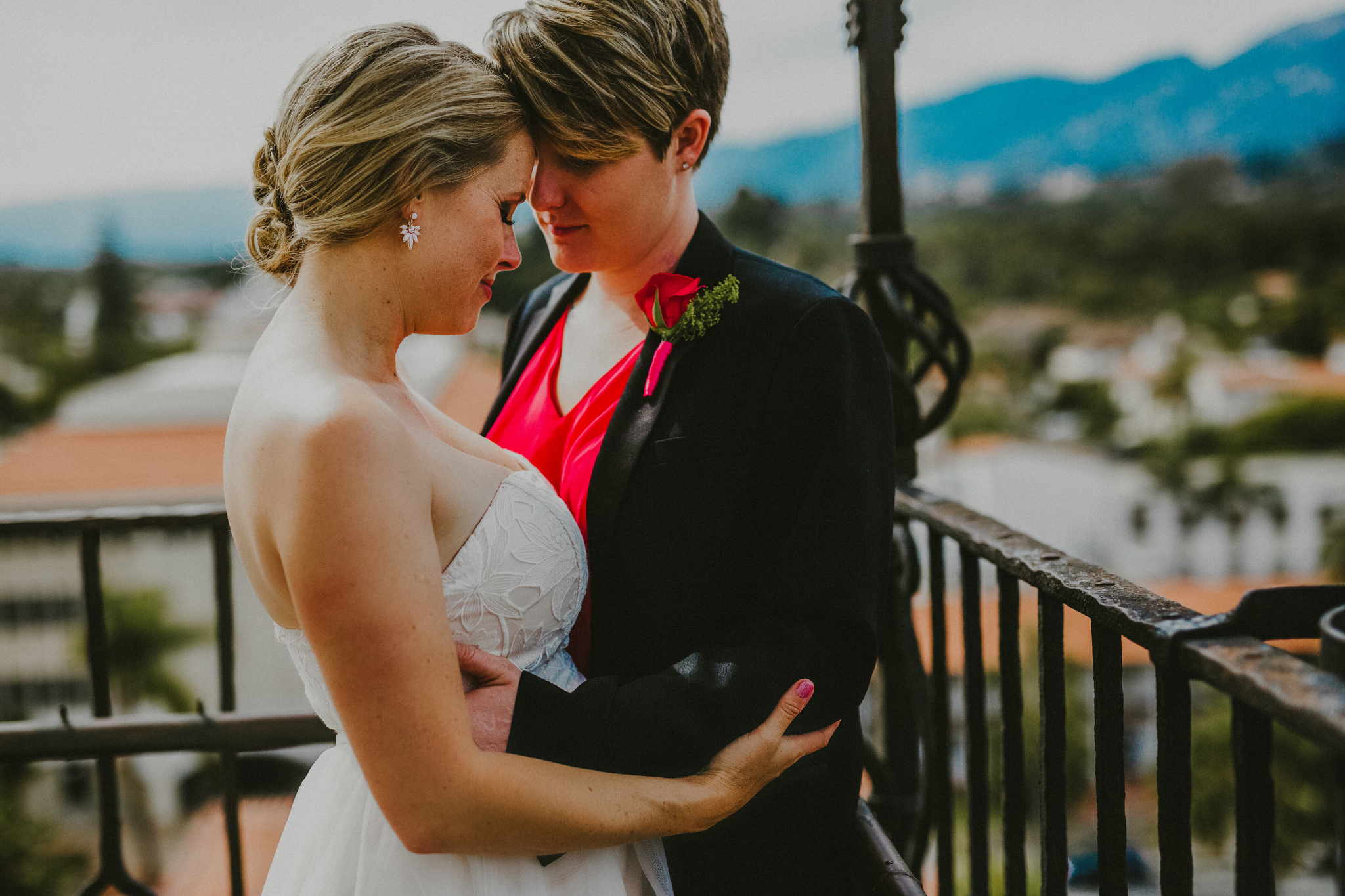 san diego wedding   photographer | woman in blazer holding woman in white dress