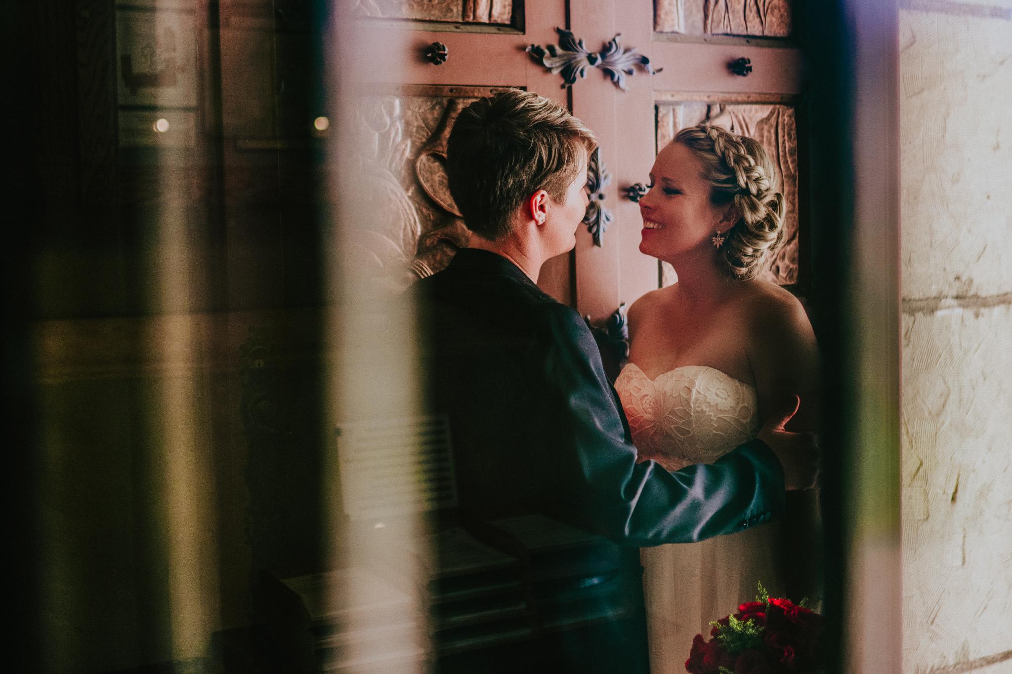 san diego wedding   photographer   women talking in front of big door
