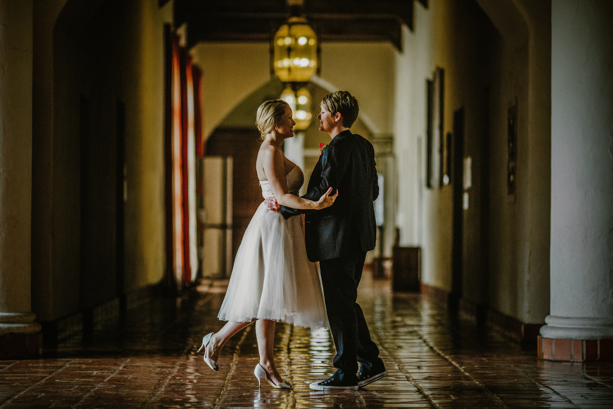 san diego wedding   photographer | woman with foot up smiling at woman