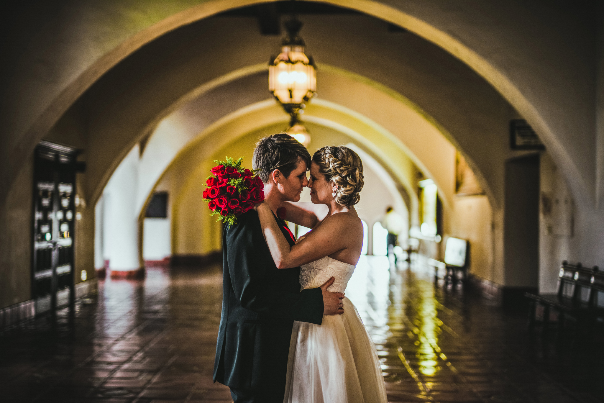 san diego wedding   photographer | women with one's arm around the other about to kiss