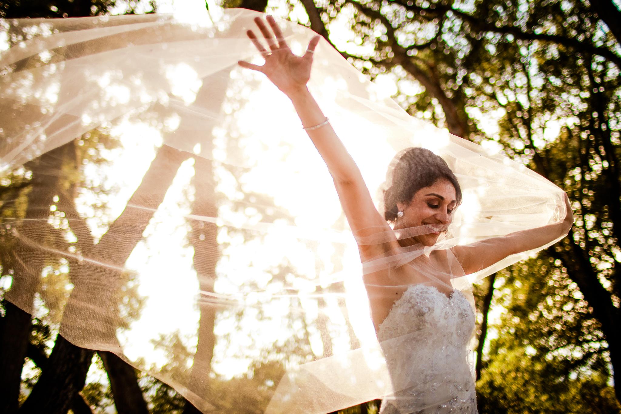 san diego wedding photographer | woman walking through veil