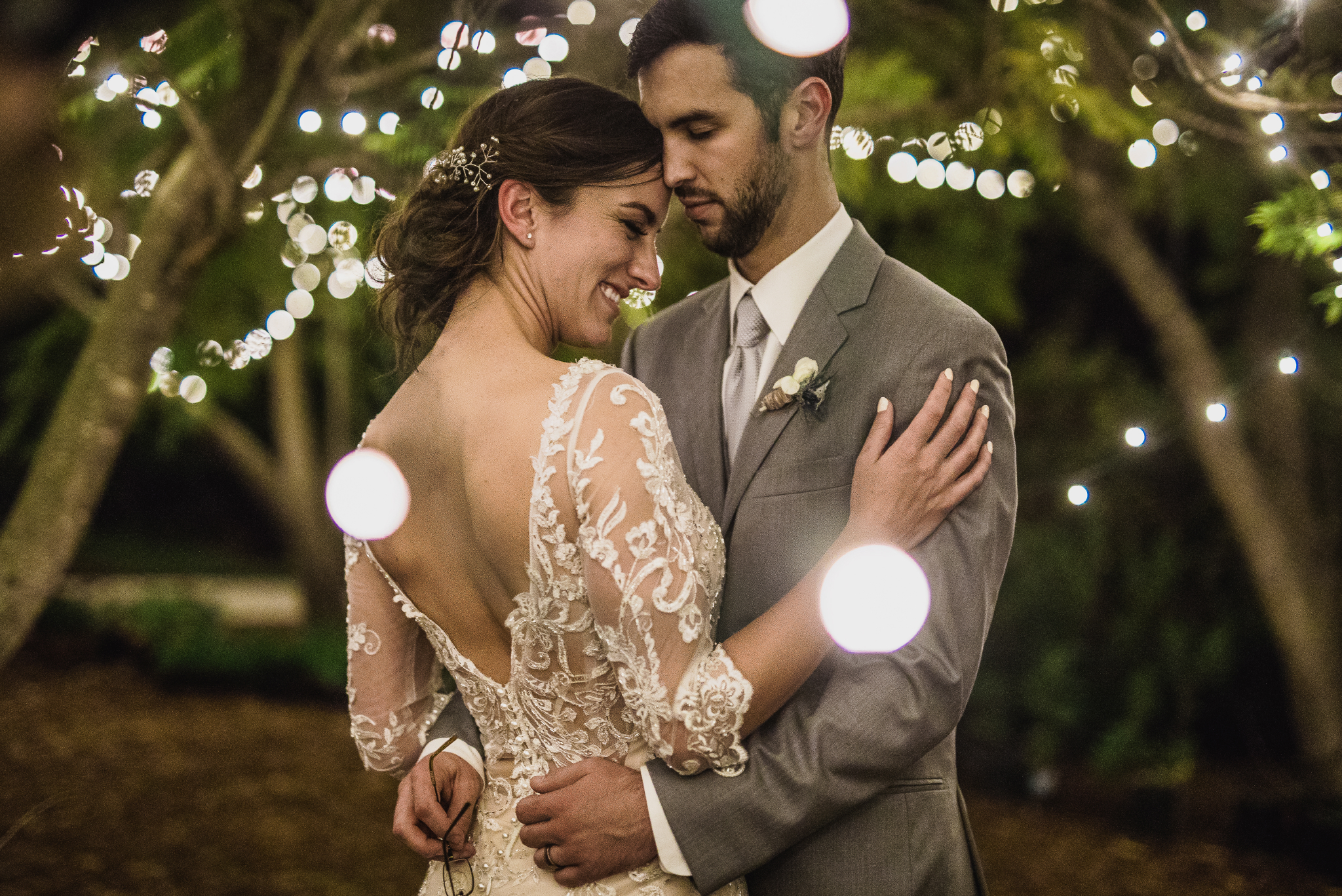 san diego wedding   photographer | couple under lights and trees