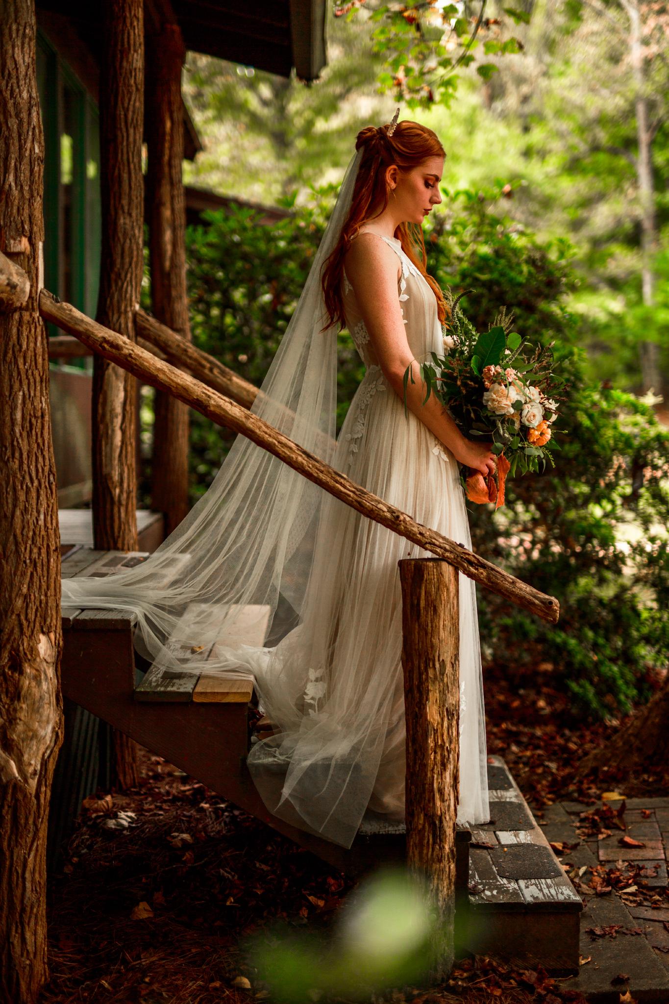 san diego wedding   photographer | woman holding flowers walking downstairs