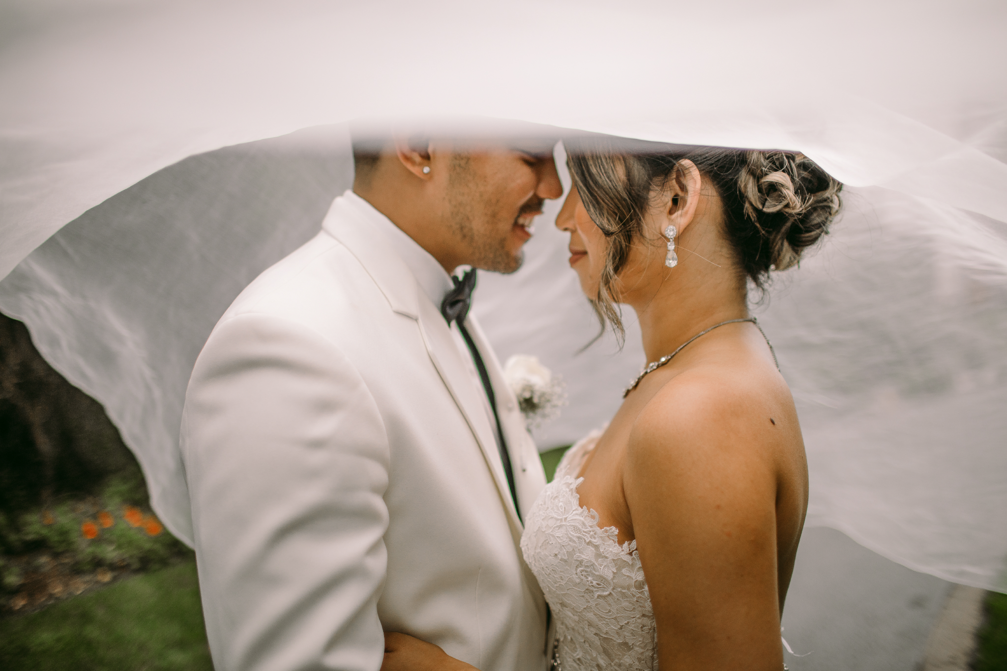 san diego wedding   photographer | couple looking at each other under cloth