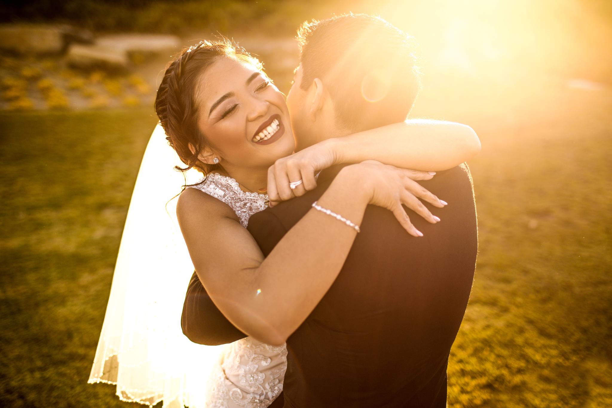 san diego wedding   photographer | couple hugging at sunset