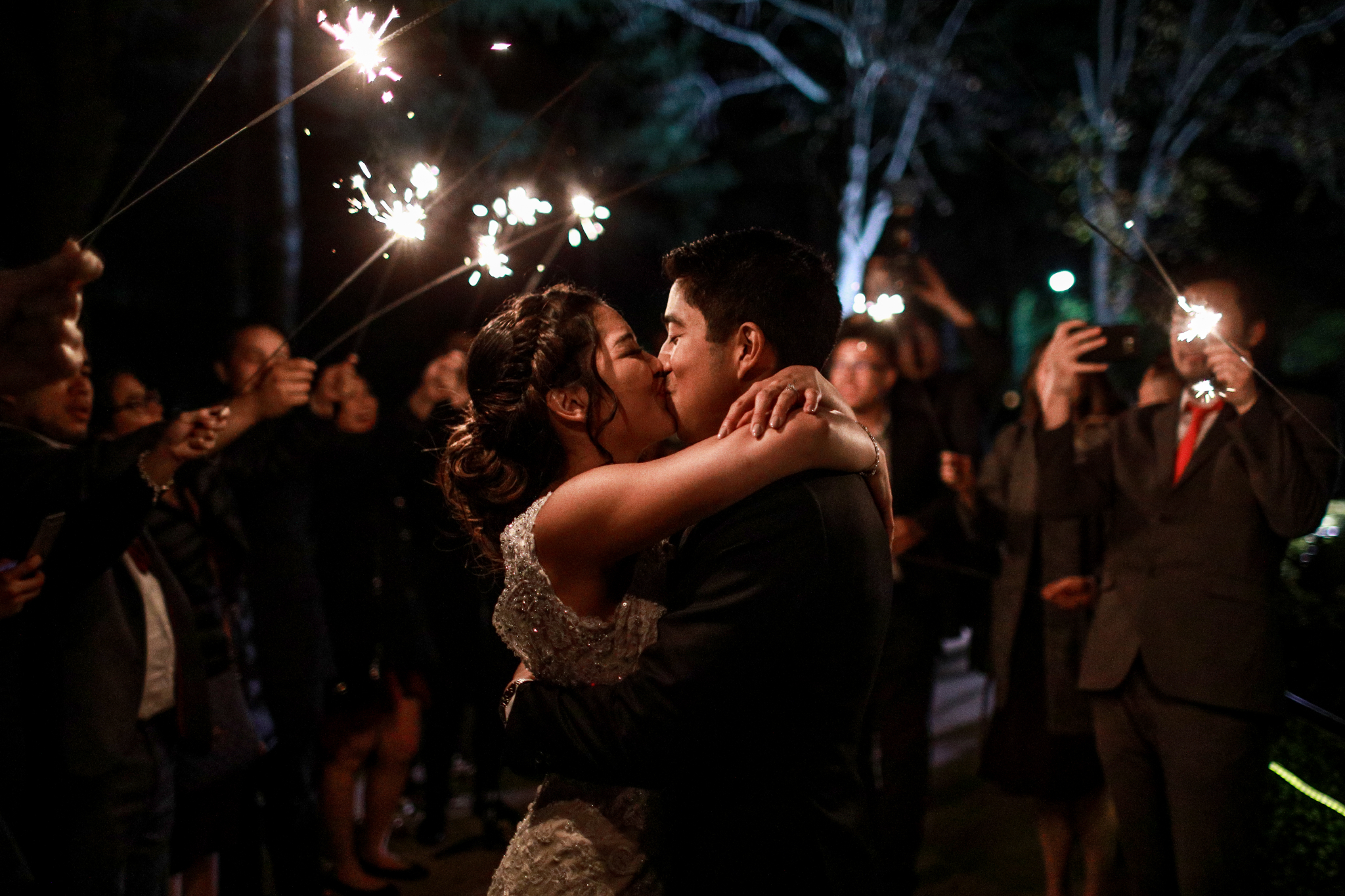 san diego wedding   photographer | couple kissing under sparklers