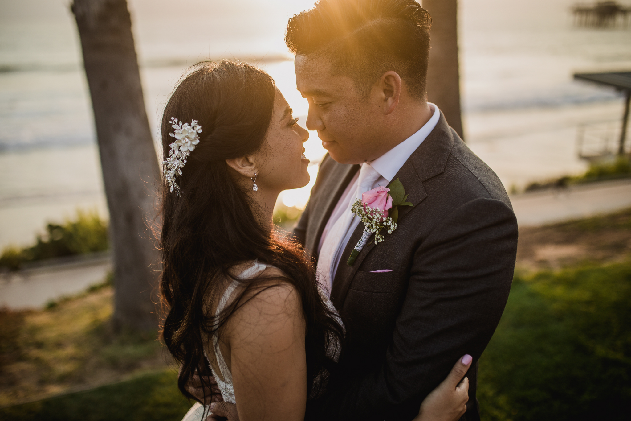 san diego wedding   photographer | couple looking at each other in front of trees