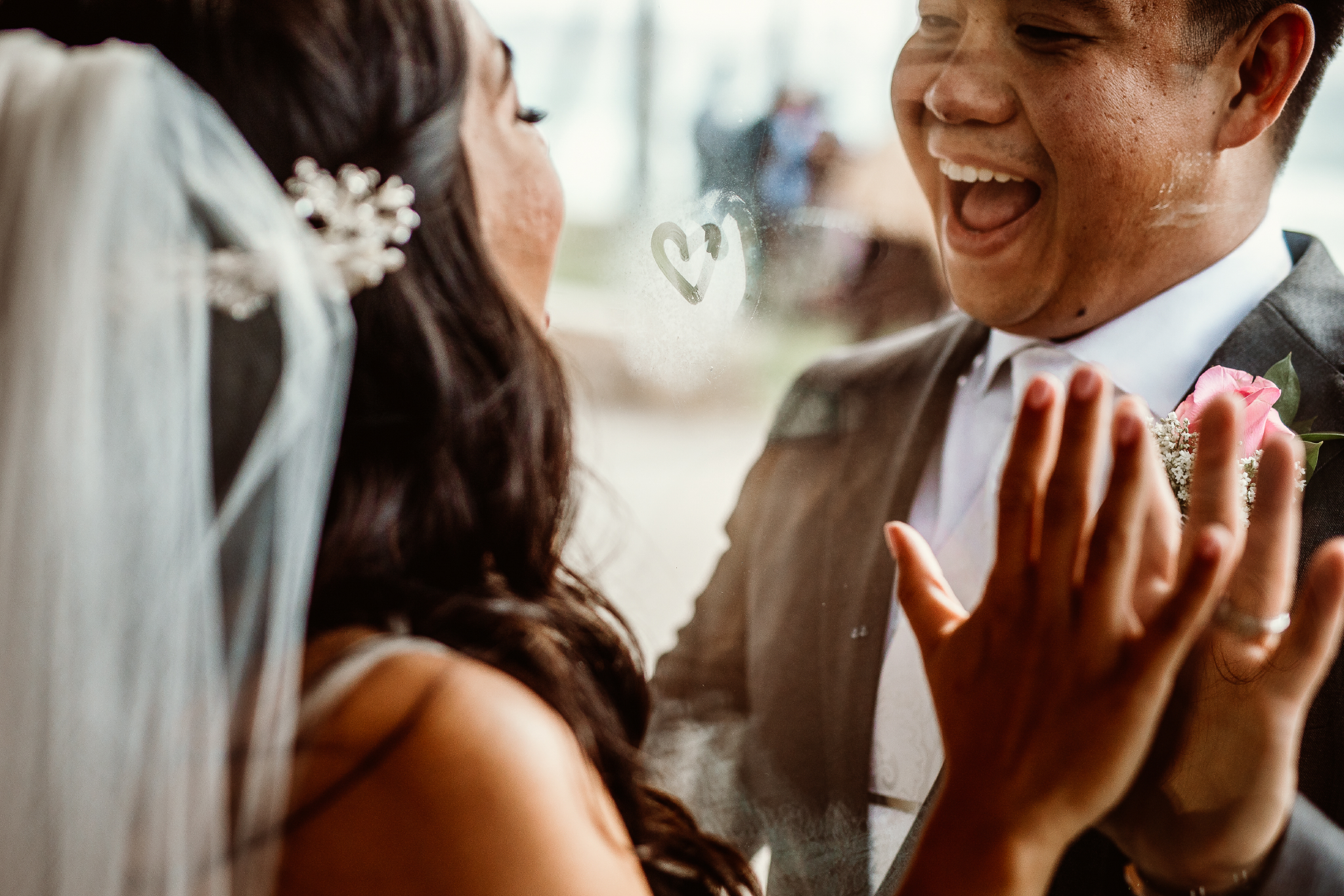 san diego wedding   photographer | couple looking at each other through glass