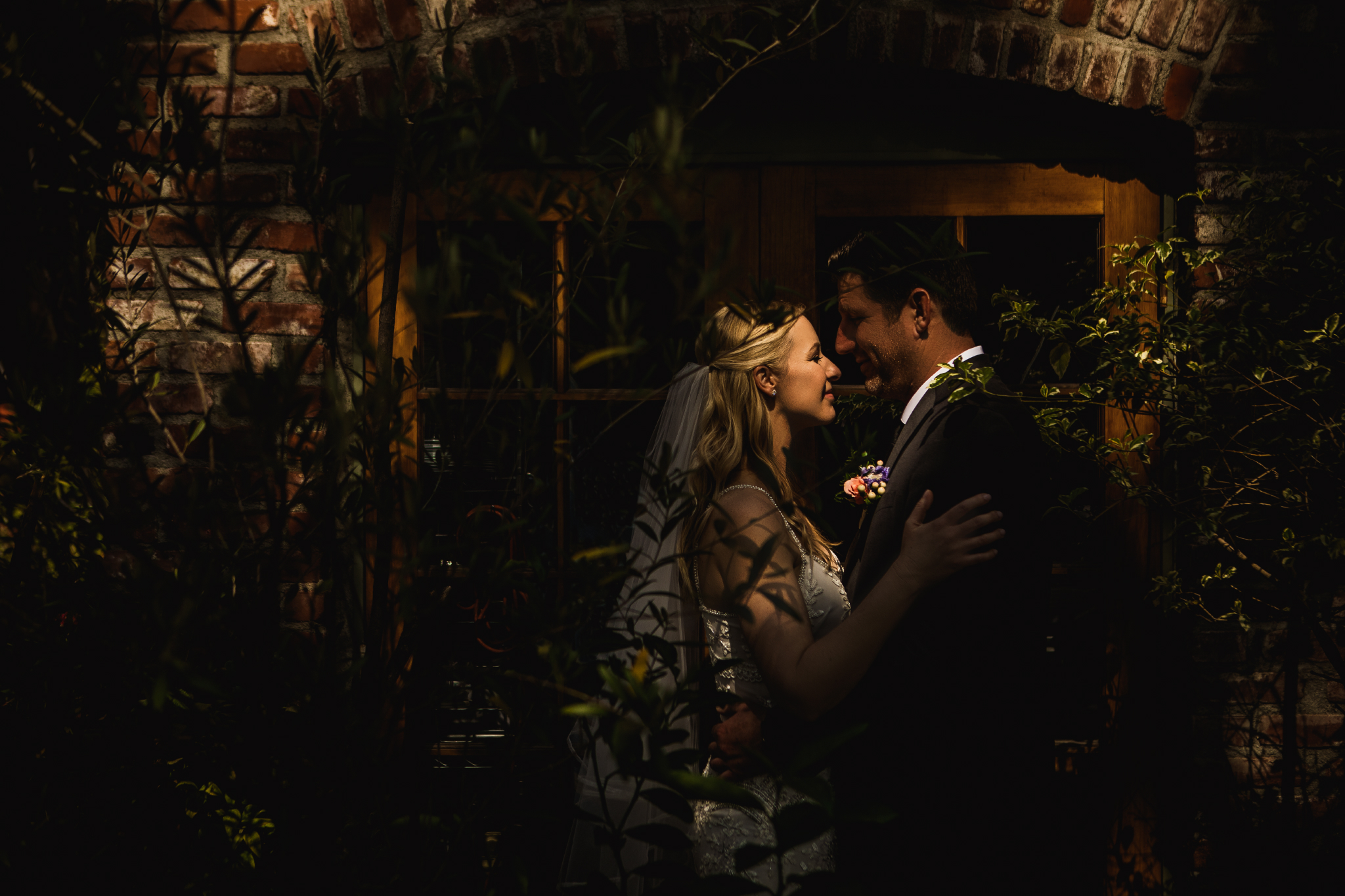san diego wedding   photographer | couple looking at each other surrounded by plants