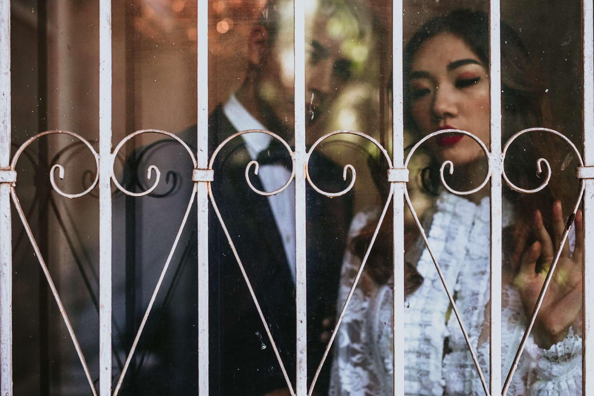 san diego wedding   photographer | couple looking behind glass gate