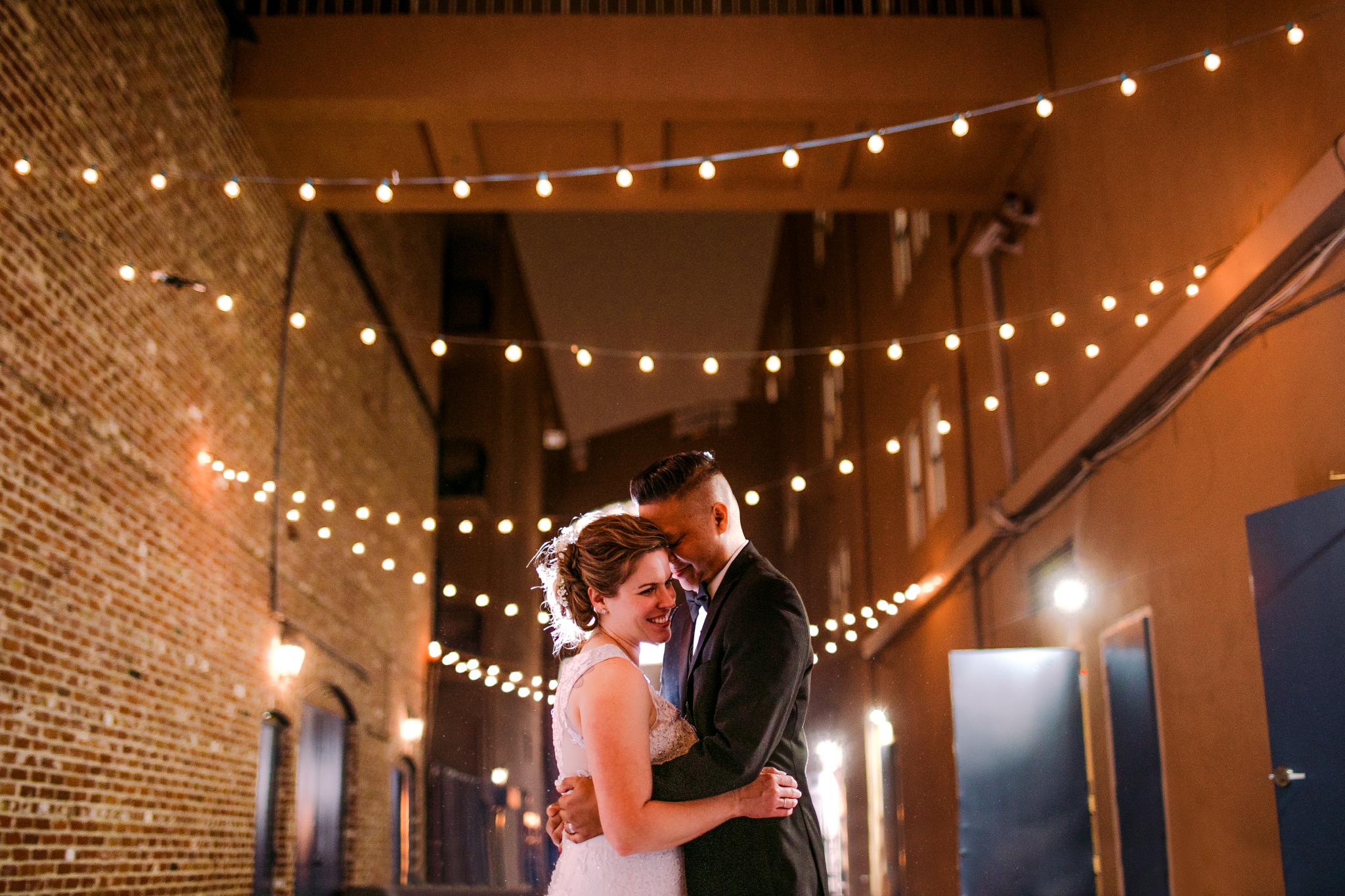 san diego wedding   photographer | couple in alleyway under lights