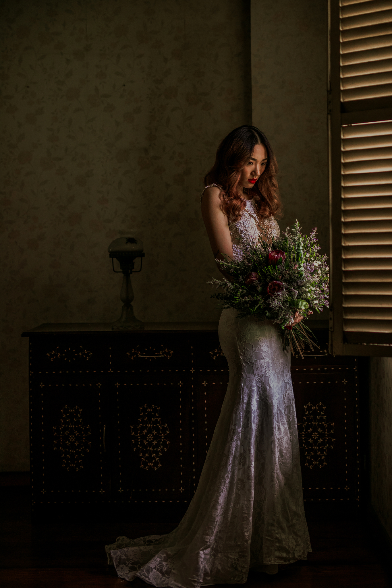 san diego wedding   photographer | woman looking down holding flowers