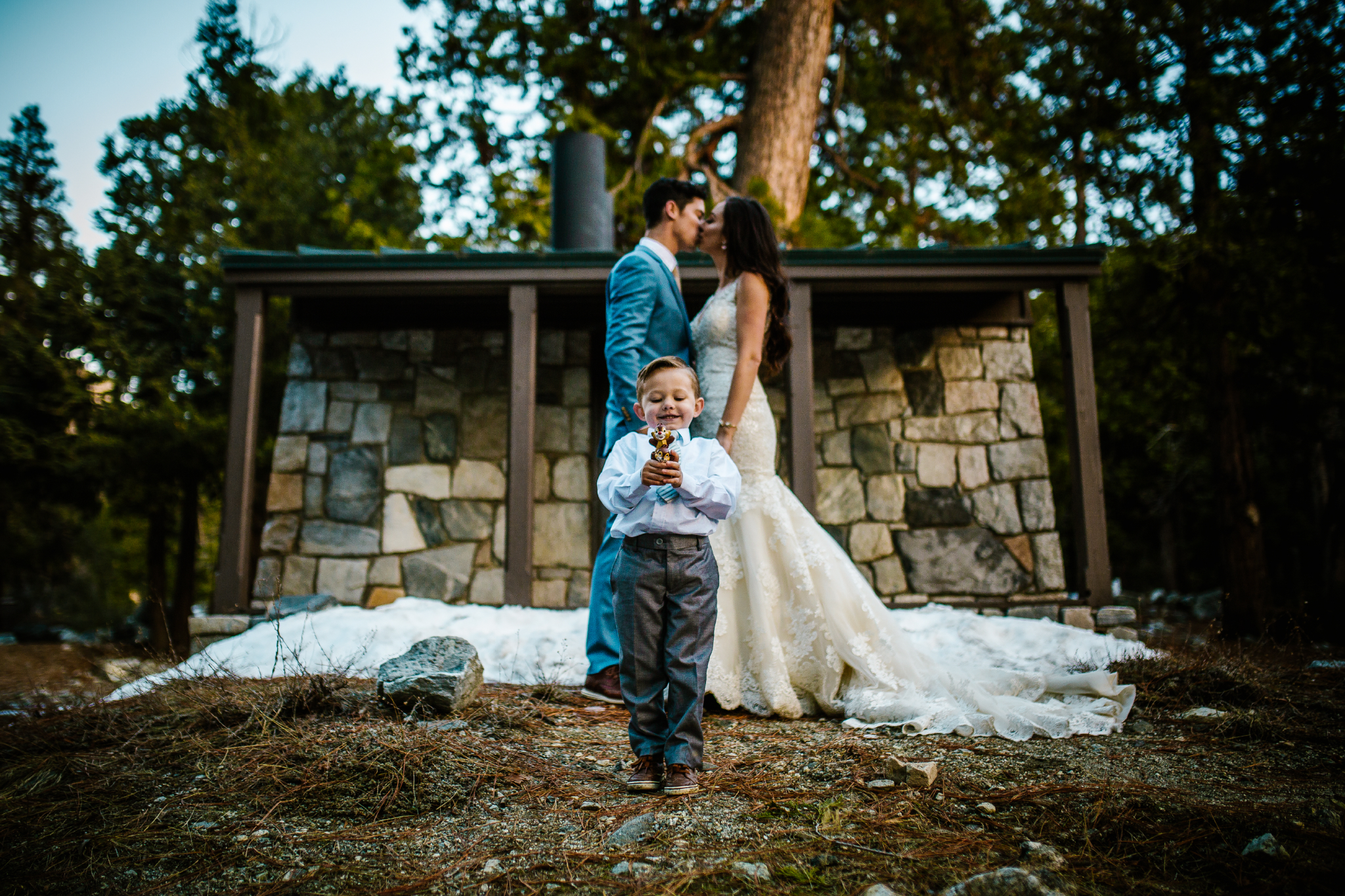 san diego wedding   photographer | couple about to kiss behind child