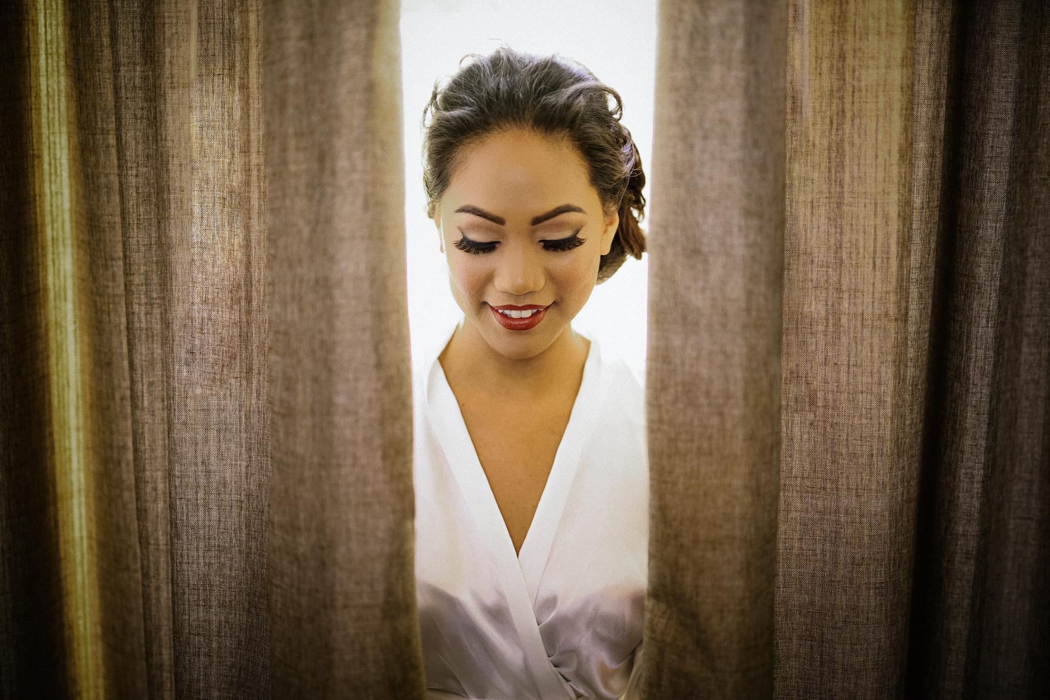 san diego wedding   photographer | woman behind curtains
